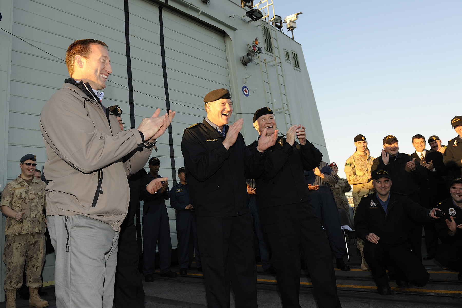 Upon his arrival in Rome, the Governor General (right) visited the HMCS Vancouver, where he met with troops. He was joined by the Honourable Peter MacKay, Minister of National Defence (left), and General Walt Natynczyk, Chief of the Defence Staff (center).