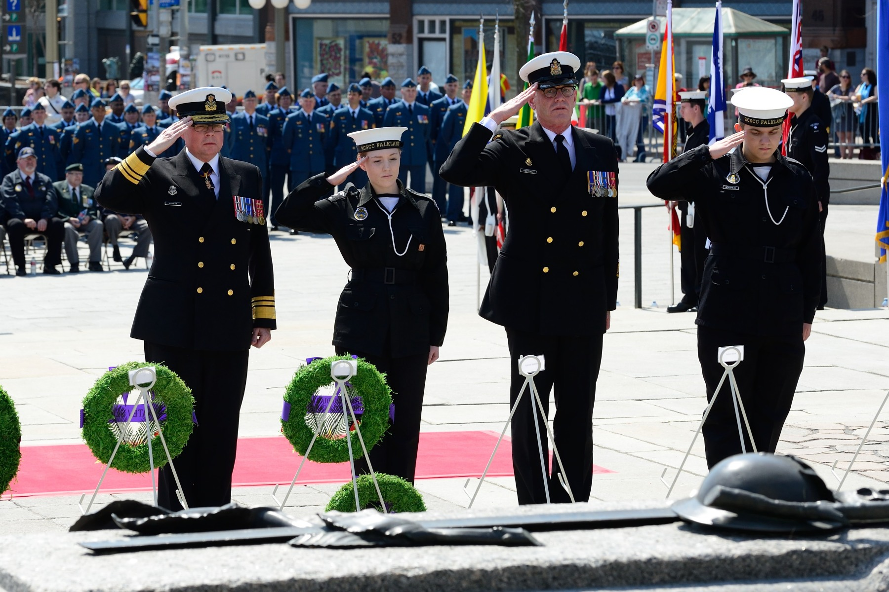 Vice-Admiral Mark Norman, Commander of the Royal Canadian Navy (left), also laid a wreath.
