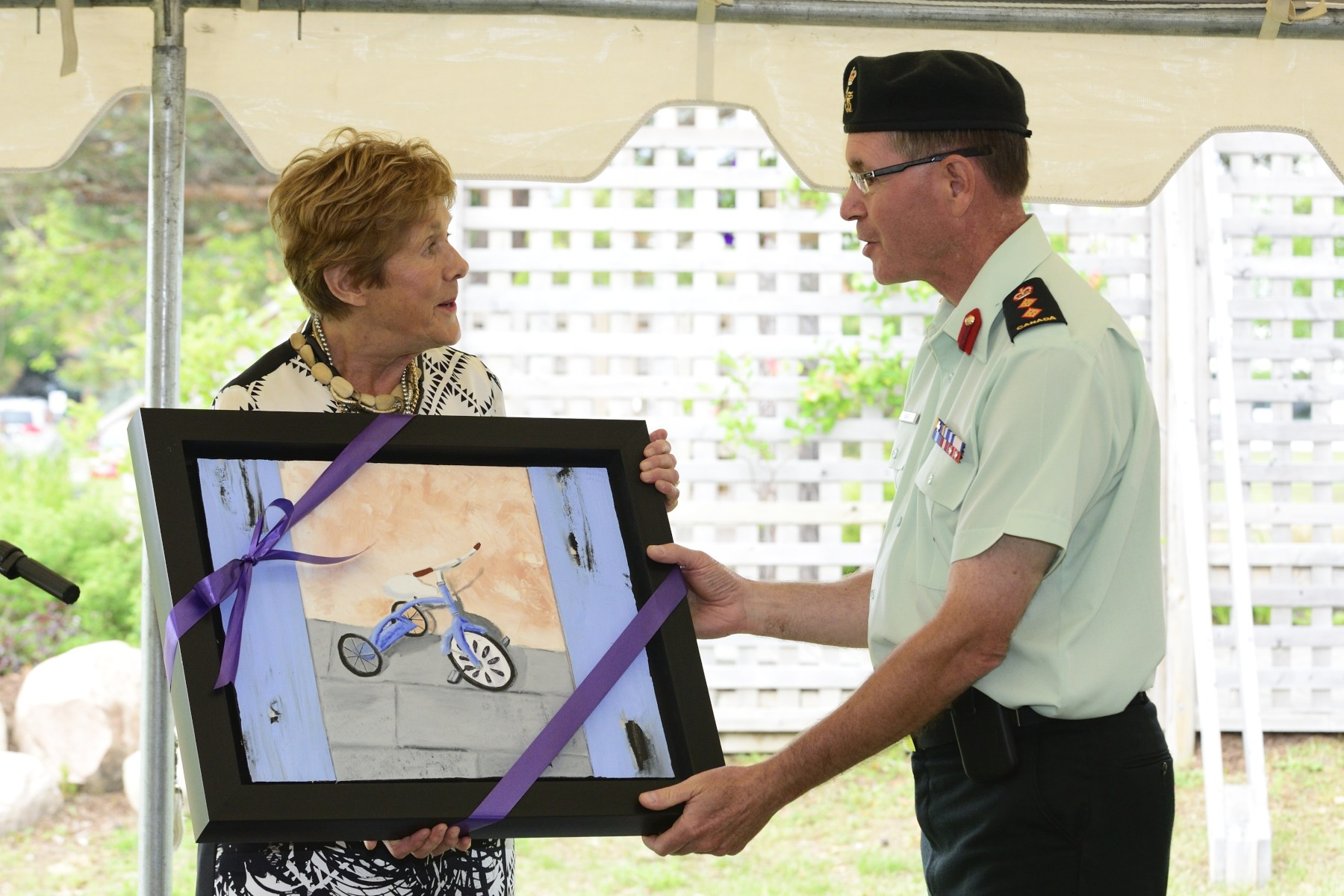 Mrs. Johnston added her own contribution to the artworks by donating a painting to Colonel Blais