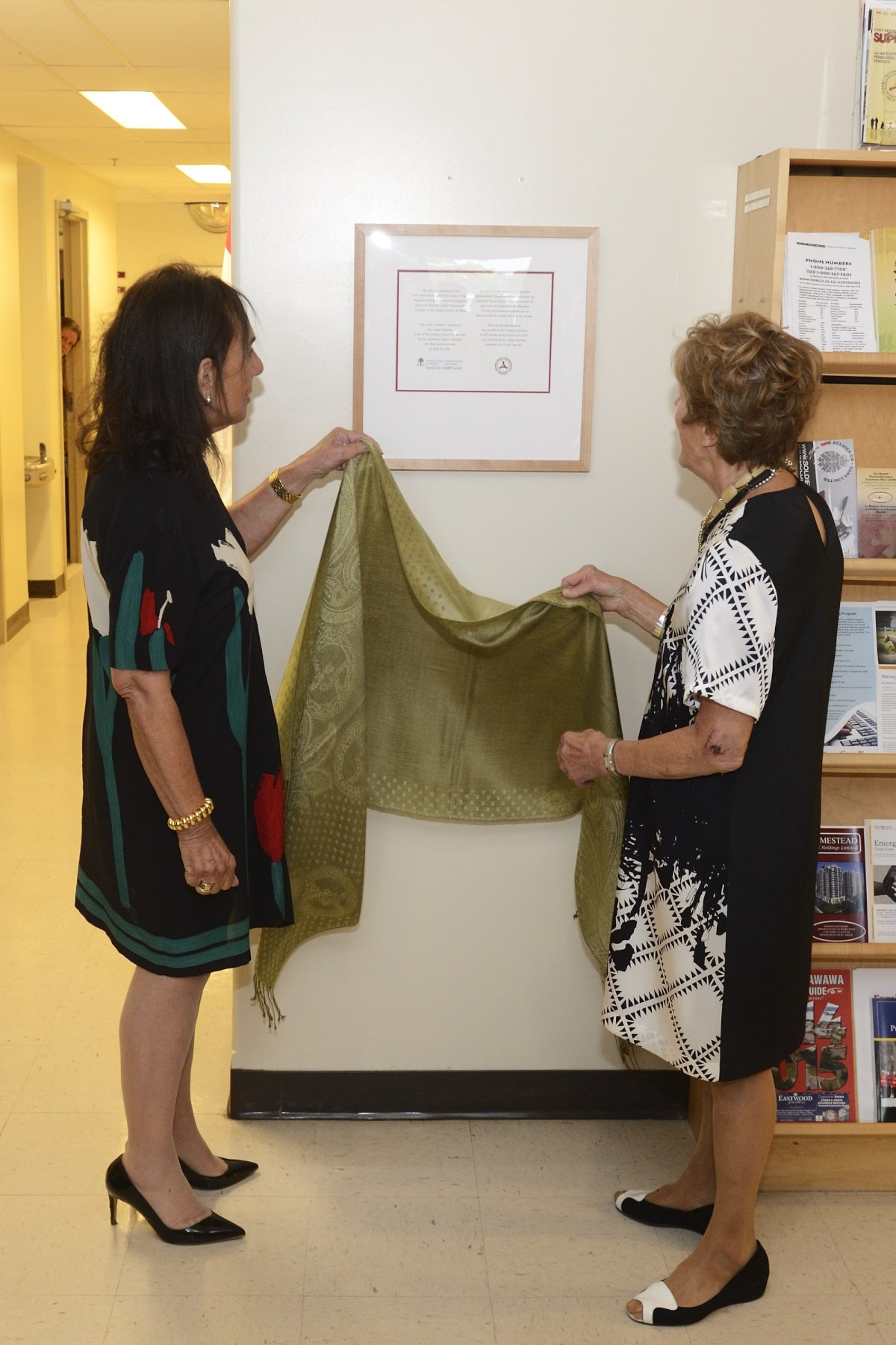 Joined by Mrs. Rotman, Mrs. Johnston unveiled the plaque. The artworks are installed in the Joint Personnel Support Unit Eastern Ontario Regional Headquarters and the Integrated Personnel Support Centre of Garrison Petawawa.