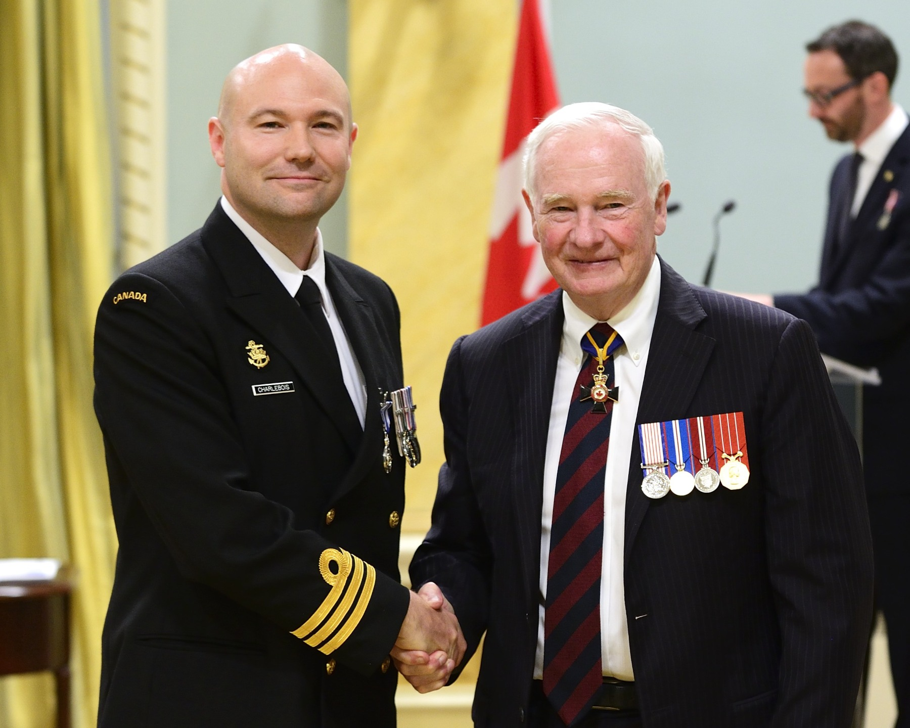 As the commanding officer of Her Majesty's Canadian Ship Regina, Commander Daniel Alan Charlebois, M.S.M., C.D. (Kingston, Ontario) was crucial to the success of two different missions between February 15 and August 3, 2014. Initially deployed in an antiterrorism role in the Indian Ocean, his ship was re-tasked on short notice to reinforce NATO allies in the Mediterranean Sea. Despite this sudden change, Commander Charlebois displayed great leadership and command presence, ensuring the crew adapted seamlessly, which brought great credit to the Canadian Armed Forces.