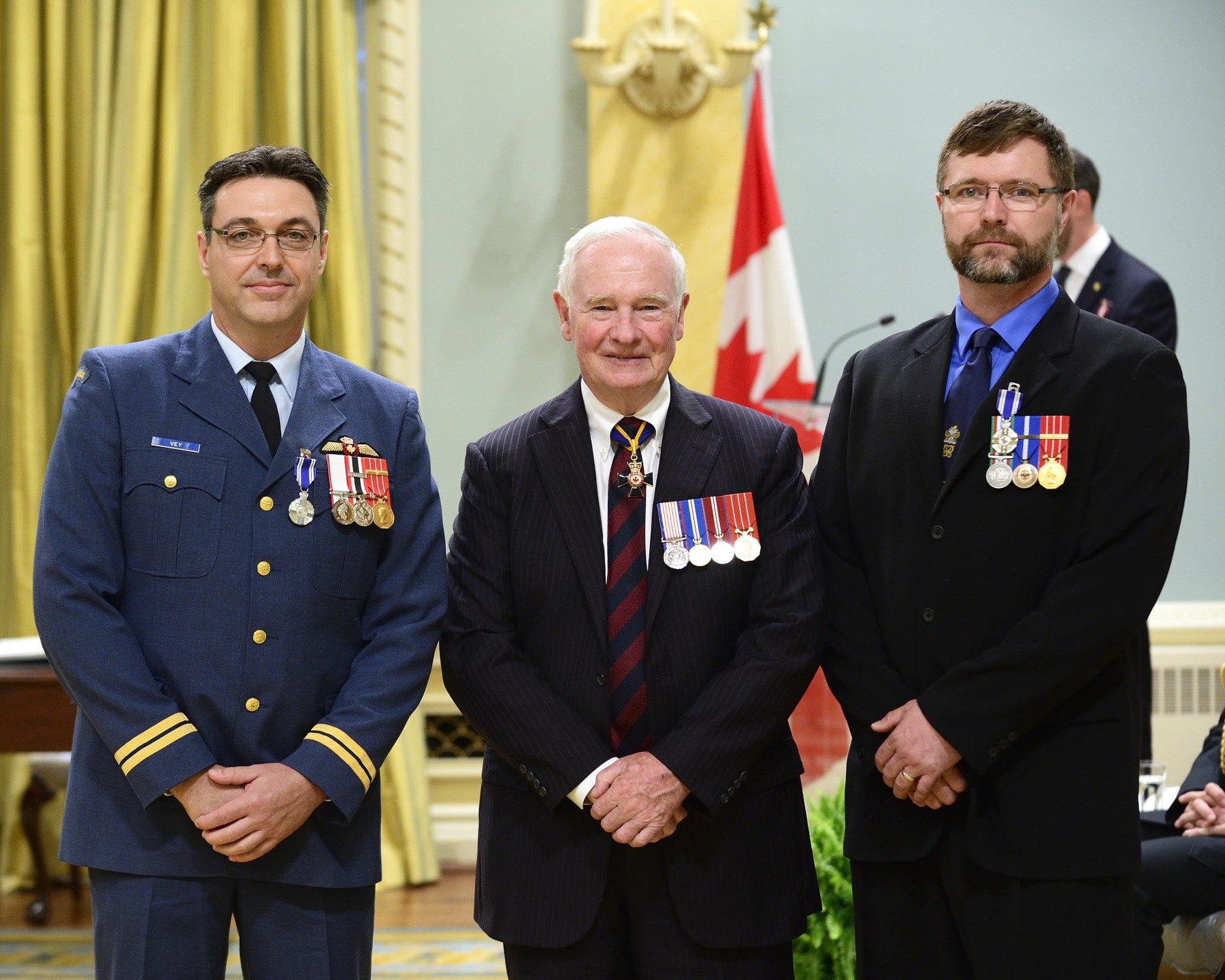 On October 27, 2011, Sergeant Bradley Douglas Hiscock, M.S.M., C.D. (Grand Falls, Newfoundland and Labrador) and Captain Dean Harvey Vey, M.S.M., C.D. (Labrador City, Newfoundland and Labrador) were respectively the flight engineer and the first officer onboard Rescue 915, a Cormorant helicopter, when they were tasked to rescue two hunters stranded in the Arctic waters near Igloolik, Nunavut. Facing high winds and rough seas, Sergeant Hiscock skilfully operated the hoist, while Captain Vey used his expert flying skills to recover the two hunters, as well as three search and rescue technicians who had previously parachuted in to assist them. Through their commendable efforts and actions, Sergeant Hiscock and Captain Vey contributed to the mission success, and brought great credit to the Canadian Armed Forces.