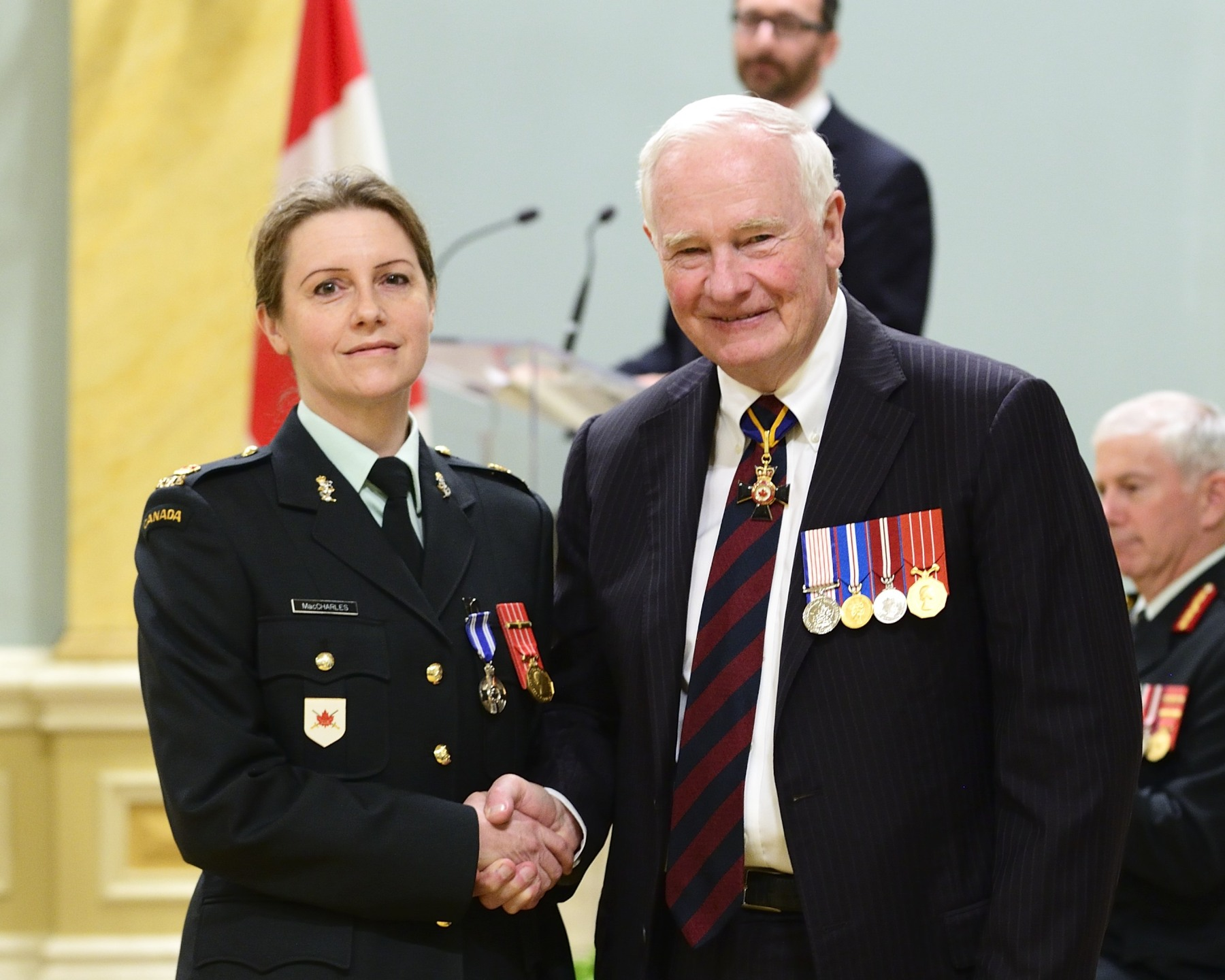 Between 2009 and 2011, Major Heather Joy MacCharles, M.S.M., C.D. (Kingston, Ontario) exhibited personal courage, professionalism and leadership in her efforts to champion the issue of family violence and sexual assault. While spearheading a Canadian Forces-wide review on the subject, she identified deficiencies in the existing Canadian Forces policy. As a direct result of her perseverance, this sensitive issue was brought to the attention of the Armed Forces Council, which resulted in a complete review of and subsequent changes to the Canadian Forces' approach.