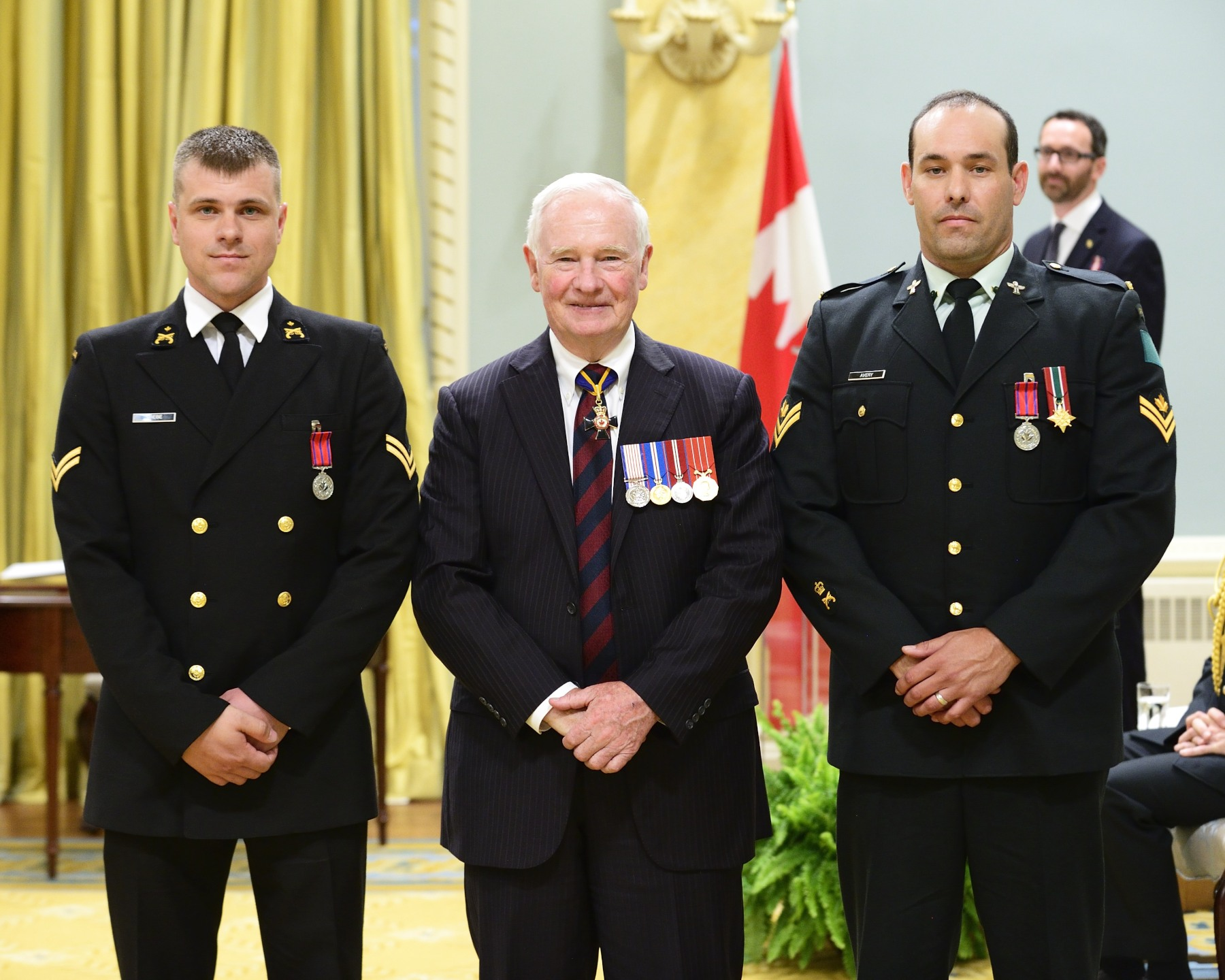 On February 6, 2013, Corporal Garet James Avery, M.B. (Sudbury and Kanata, Ontario) and Ordinary Seaman Benne Wiebe, M.B. (Aylmer, Quebec and Kingston, Ontario) put their lives at risk to prevent a man from setting himself on fire in Kingston, Ontario. They slowly approached the distraught man and pinned him to the ground before he could set fire to his gasoline-soaked clothing, thus saving him from tragedy.