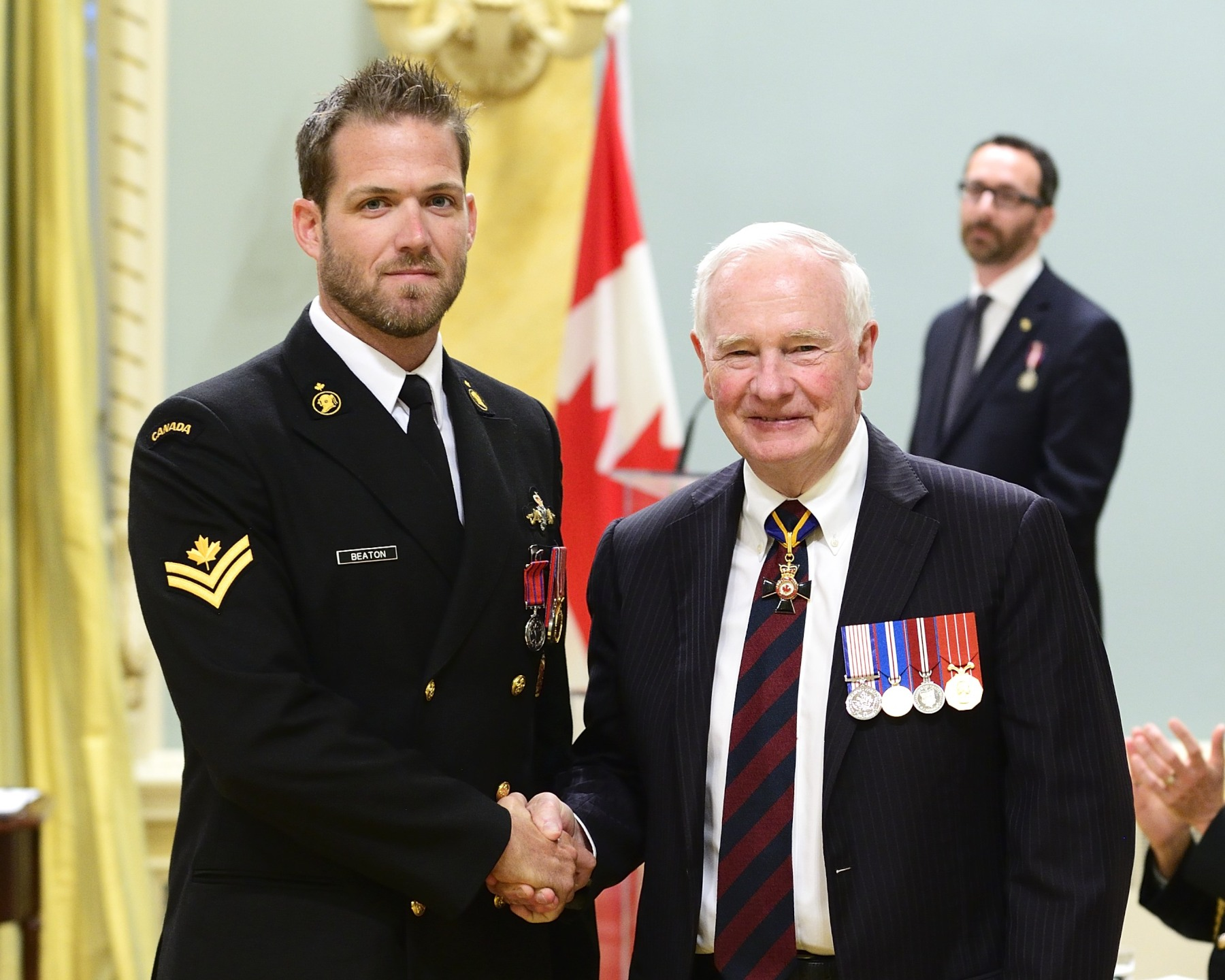 On June 19, 2013, Leading Seaman Evan Beaton, M.B., C.D. (New Haven, Prince Edward Island and Lawrencetown, Nova Scotia) rescued a fellow diver who had become tangled in his lifeline during a deep-diving operation in the Bedford Basin, in Halifax, Nova Scotia. Leading Seaman Beaton was forced to disregard the normal safe rate of descent to reach the victim, whose air supply was severely limited. At great personal risk, Leading Seaman Beaton then skipped decompression protocol to bring the victim quickly to the surface, thus saving his life.