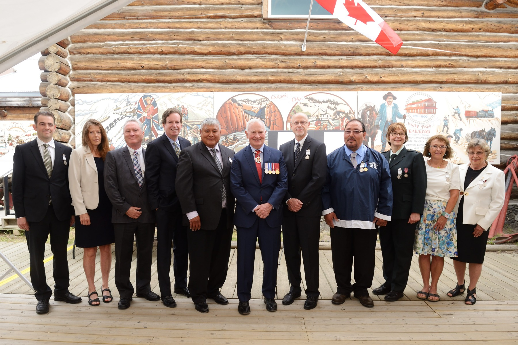 The Governor General is accompanied by the first 10 recipients of the Polar Medal.