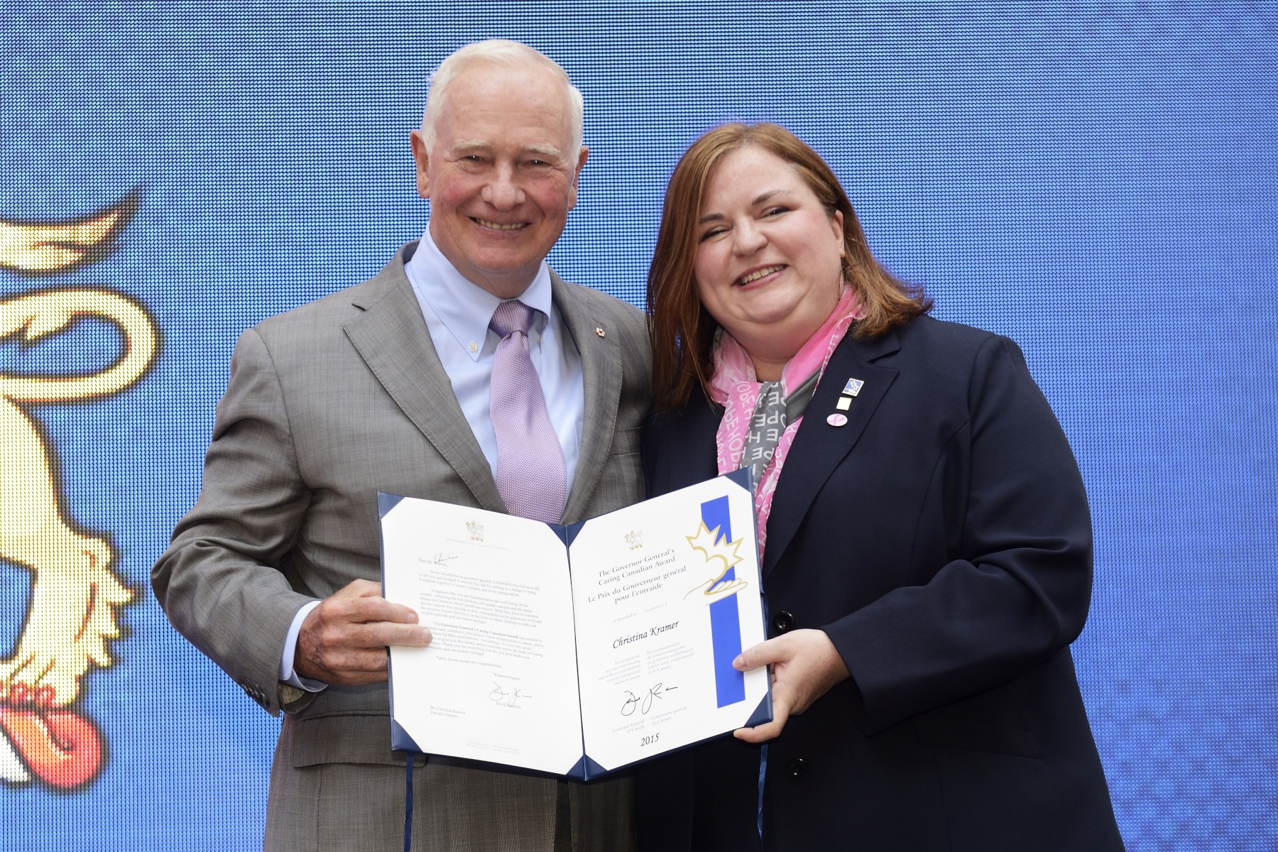During the event, the Governor General presented the Caring Canadian Award to Ms. Christina Kramer, CIBC's lead volunteer and executive sponsor for the Canadian Breast Cancer Foundation CIBC Run for the Cure.