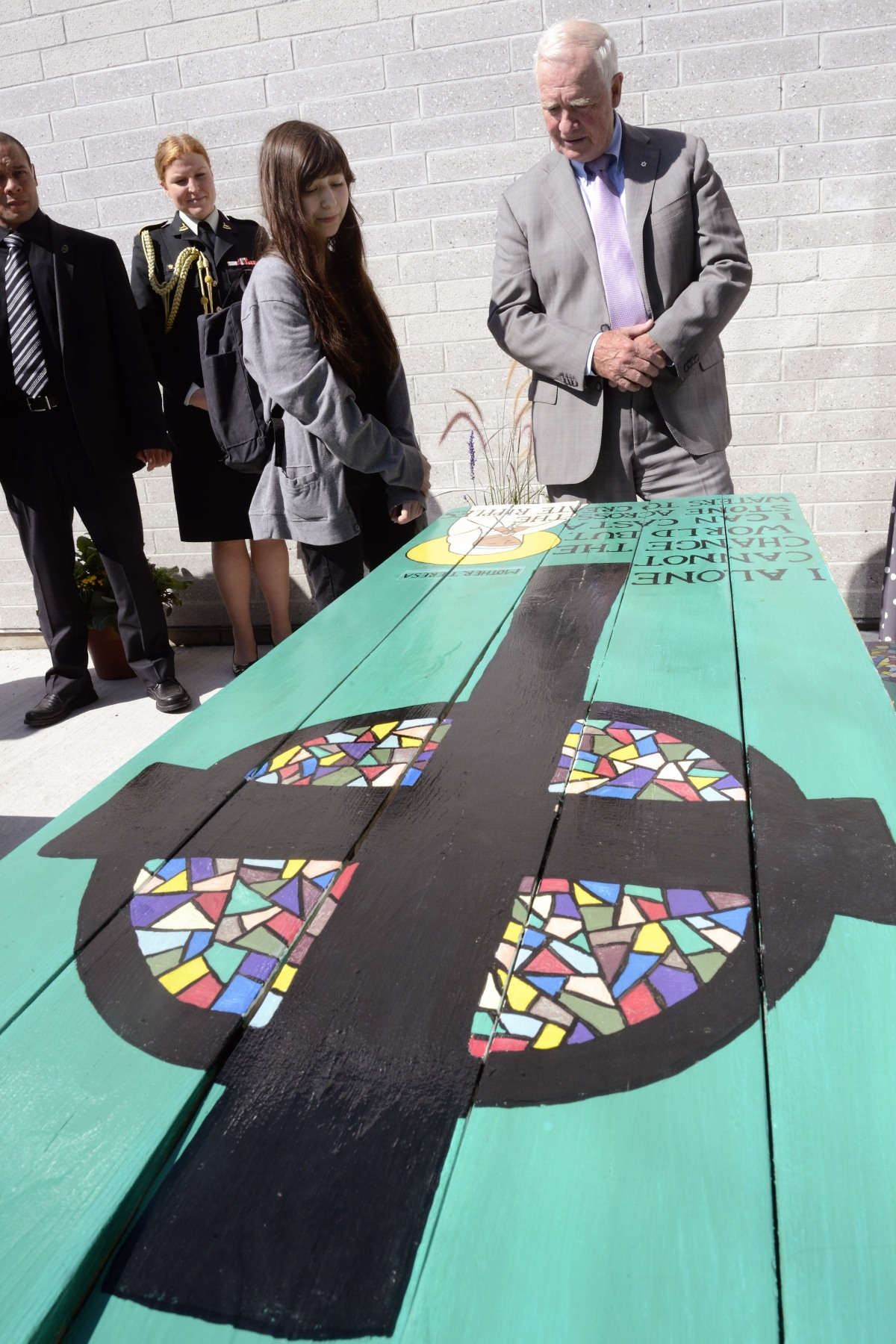 His Excellency had the opportunity to see examples of the talent of the Monsignor Fraser College's students like these beautiful paintings decorating picnic tables.