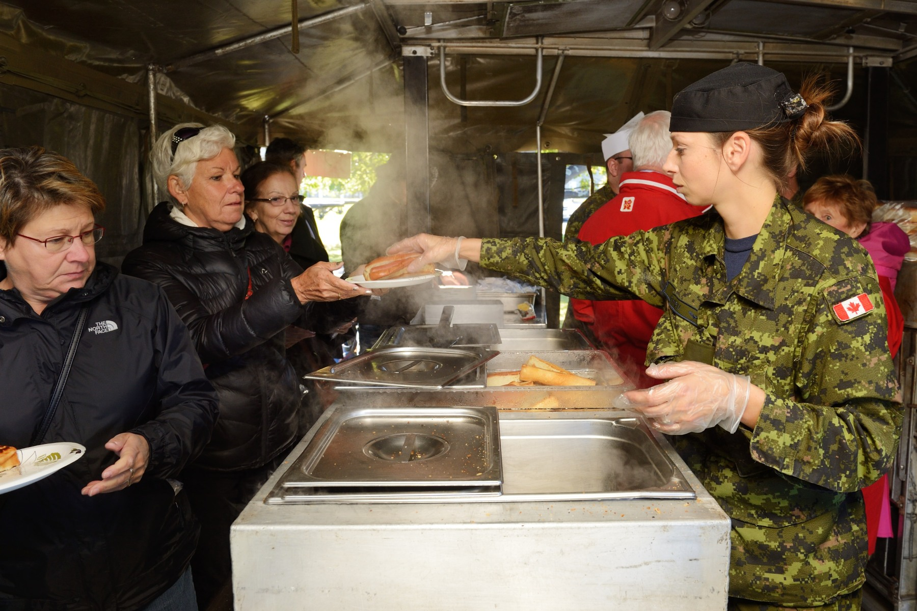 Visitors enjoyed hot food served by a field kitchen.