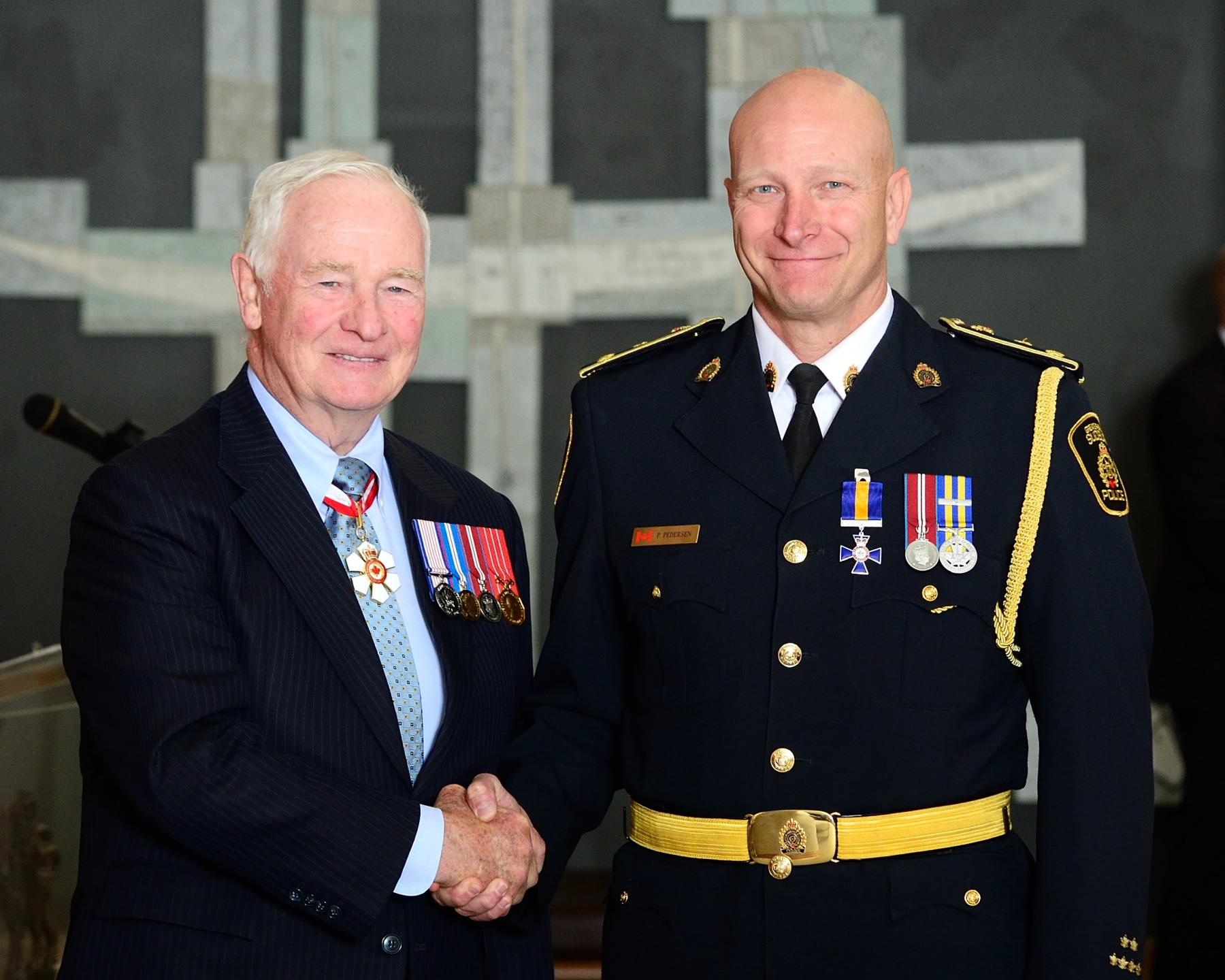 The Governor General presented the Order at the Member level to Chief Paul E. Pedersen, M.O.M., Greater Sudbury Police Service, Ontario.