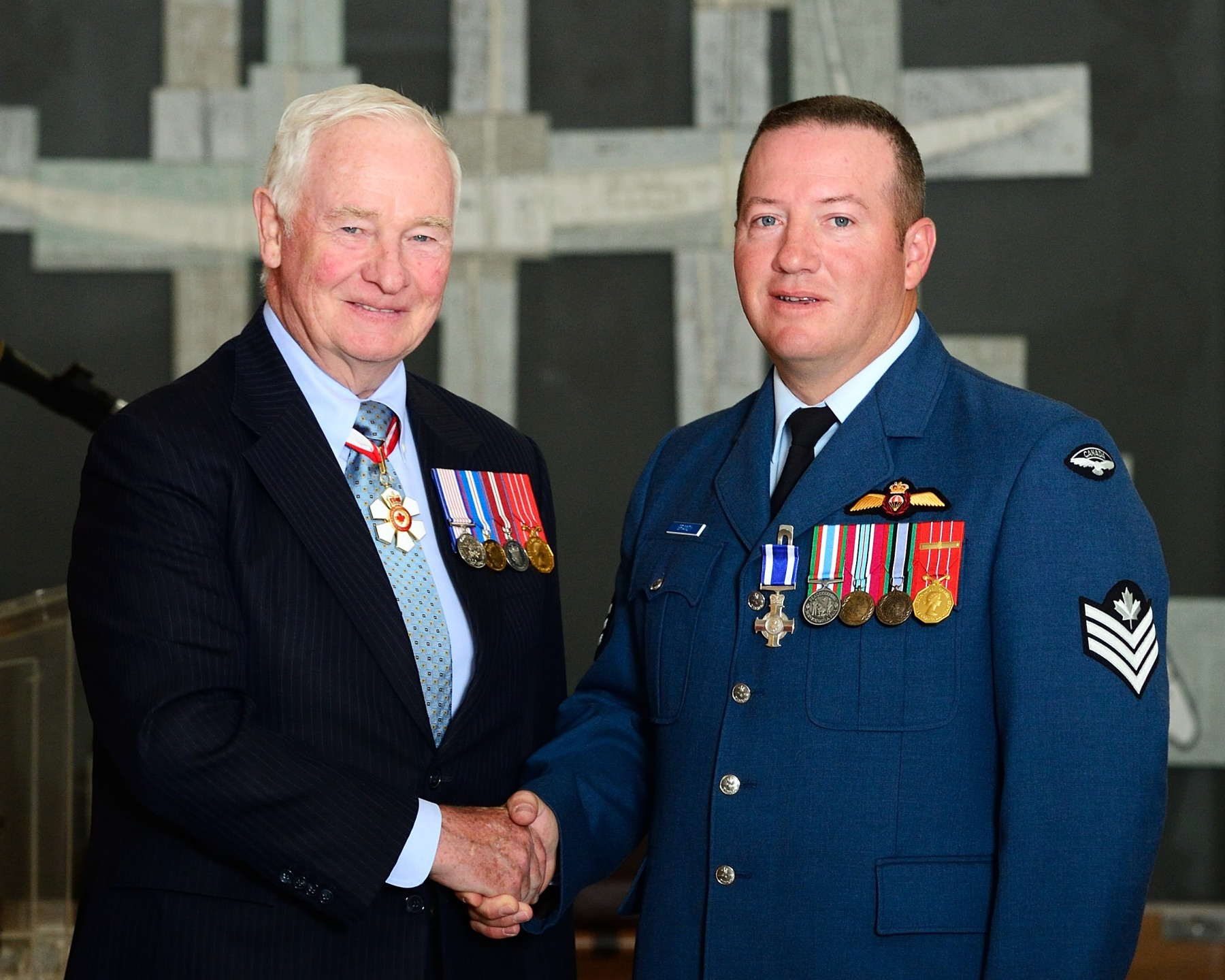 The Governor General presented the Meritorious Service Cross (Military Division) to Sergeant Terrence Gregory Grandy, M.S.C., C.D. On September 20, 2011, search and rescue technician Sergeant Grandy successfully evacuated three Belgian sailors from a damaged vessel during a severe storm in the Atlantic Ocean. Lowered from the Rescue 908 helicopter onto the vessel, Sergeant Grady was able to keep the rescue basket under control during the hoisting operation despite the gusting winds and high sea swells. Sergeant Grandy's tenacity as well as his professionalism under difficult environmental conditions brought great credit to himself, to the Royal Canadian Air Force and to Canada