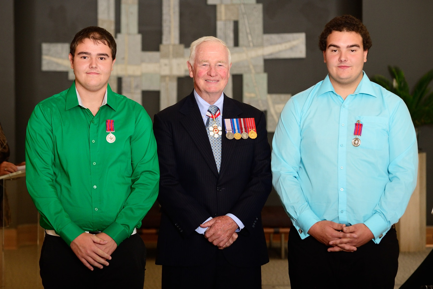 The Governor General presented the Medal of Bravery to Junior Larochelle, M.B. and Steven Larochelle, M.B. On January 3, 2012, Junior Larochelle and Steven Larochelle rescued a man whose ATV had broken through the ice of Petit lac Long, in Saint-Jacques-le-Majeur-de-Wolfestown, Quebec. The two brothers rushed to the victim who was clinging to the edge of the ice in his heavy, waterlogged clothing. They lay down on the fragile surface and, working as a human chain, pulled the man out of the water.