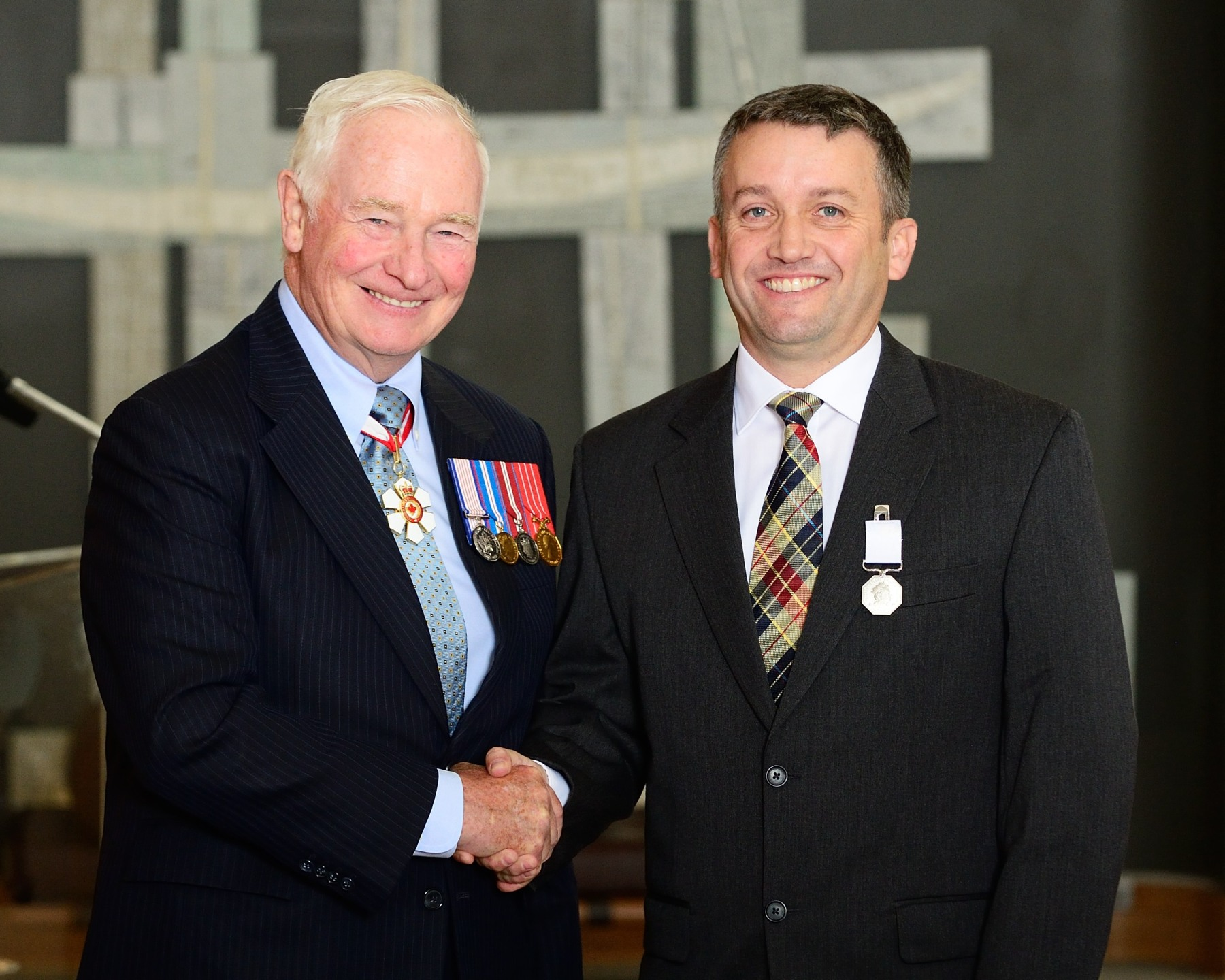 The Governor General presented the Polar Medal to Jonathan Moore, of Ottawa, Ontario. As a senior underwater archaeologist and sonar operator, Mr. Moore helped to unlock the mysteries of the lost Franklin Expedition. He spent six field seasons between 2008 and 2014 searching the Arctic Ocean for the wreck of HMS Erebus, and was part of the Parks Canada team that discovered and dived on the shipwreck in September 2014.