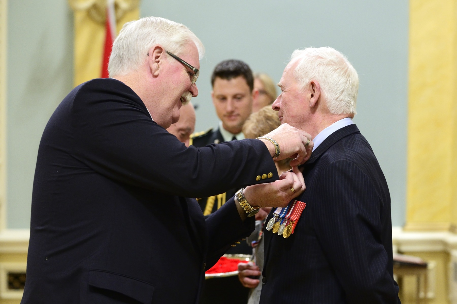 His Excellency received the symbolic first poppy of the campaign from Comrade Tom Eagles, Dominion President of The Royal Canadian Legion. Poppies will be available to the general public beginning Friday, October 30, 2015.