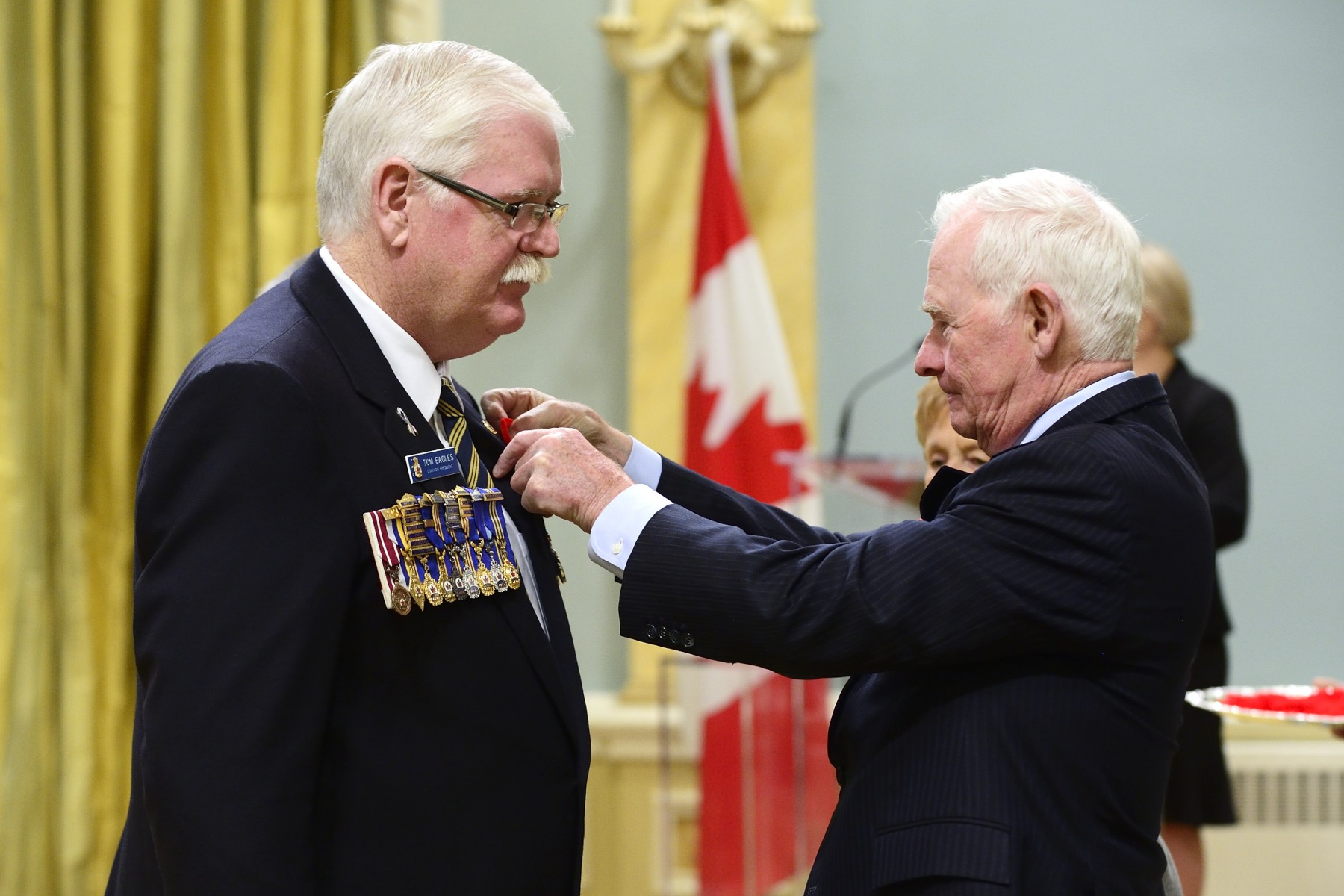 The Governor General then presented a poppy to Mr. Eagles.