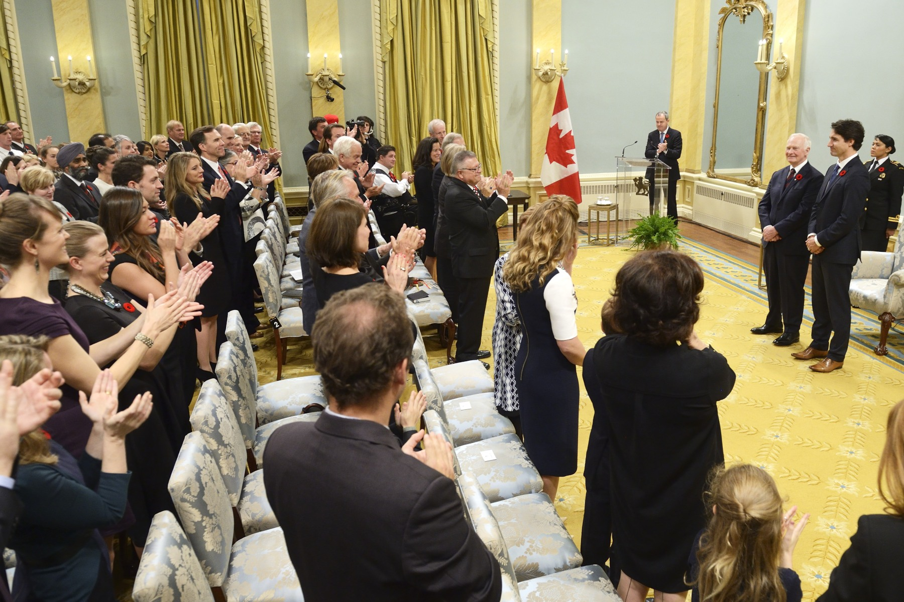 The new Prime Minister received a warm standing ovation.