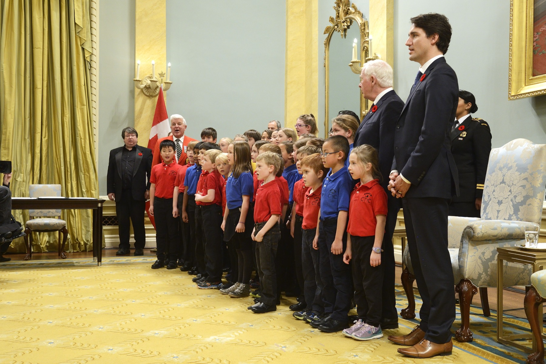 The swearing-in ceremony ended with the National Anthem sung by the Cross Town Youth Chorus.