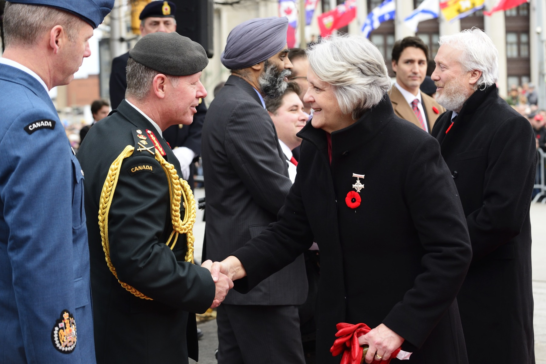Upon her arrival at the National War Memorial, 2015 National Silver Cross Mother Mrs. Sheila Elizabeth Anderson was greeted by the Chief of the Defence Staff General Jonathan Vance. Her son Corporal Jordan James Anderson was killed by an improvised explosive device, on July 4, 2007, in Afghanistan.