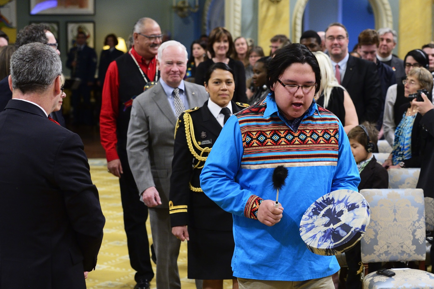 Isaac Henson, First Nation drummer, led a procession that included the Governor General and Mr. Eugène Arcand, Indian Residential School survivor and member of the Governing Circle of the National Center for Truth and Reconciliation (NCTR), on the occasion of the inaugural Imagine a Canada ceremony held at Rideau Hall.