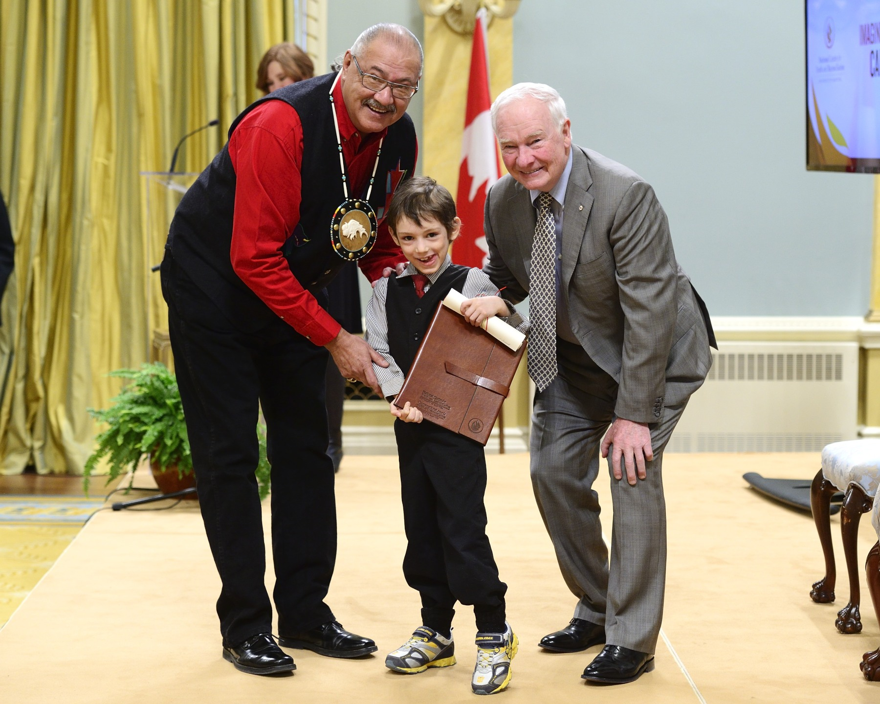 Laurick Corriveau, a grade 2 student, traveled from Carcross, Yukon, to attend the ceremony. He received a certificate from the Governor General and a gift from Mr. Arcand.