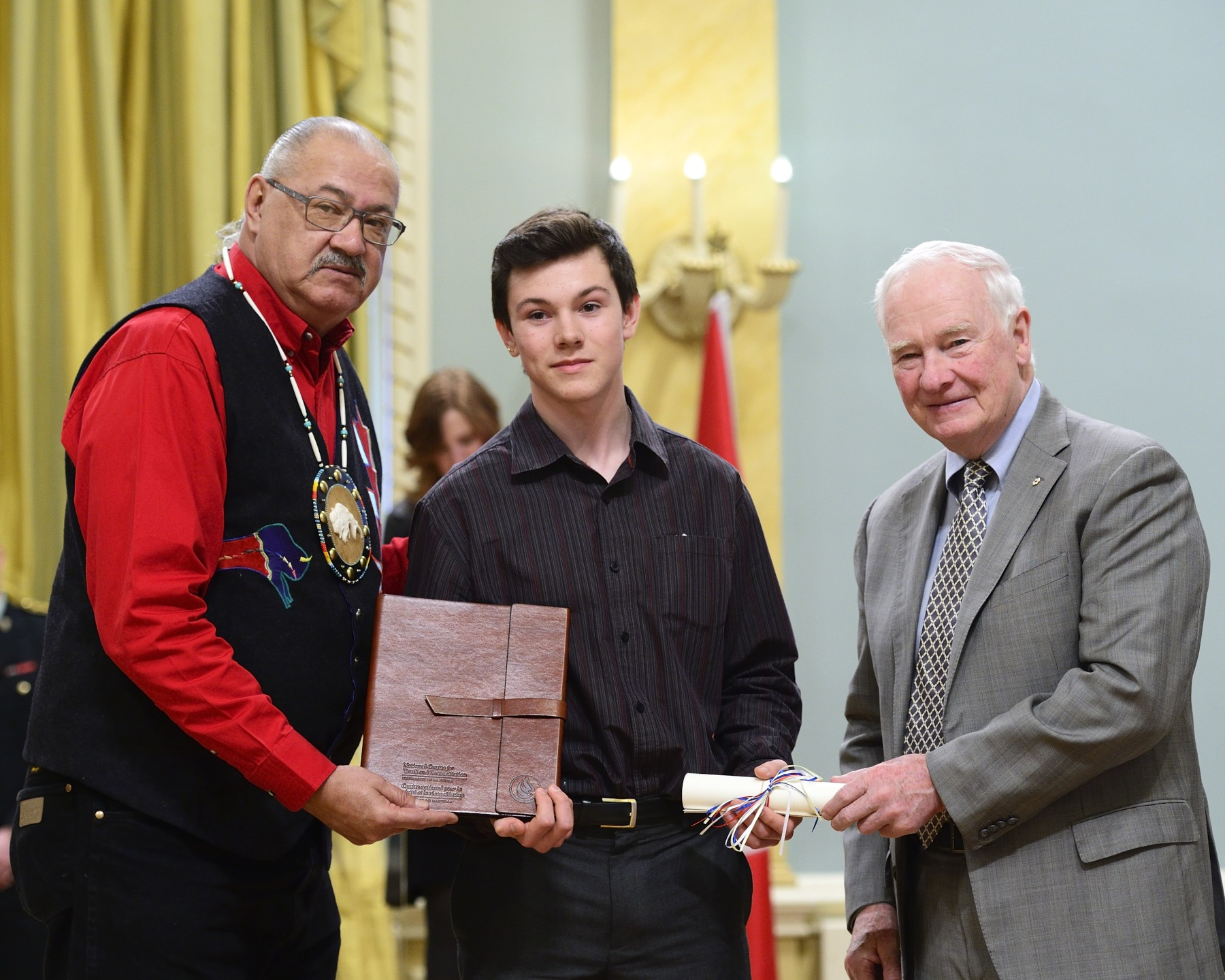 Christopher Sanford Beck, a grade 10 student from Cochin, Saskatchewan, received a certificate and a gift from the Governor General and Mr. Arcand.
