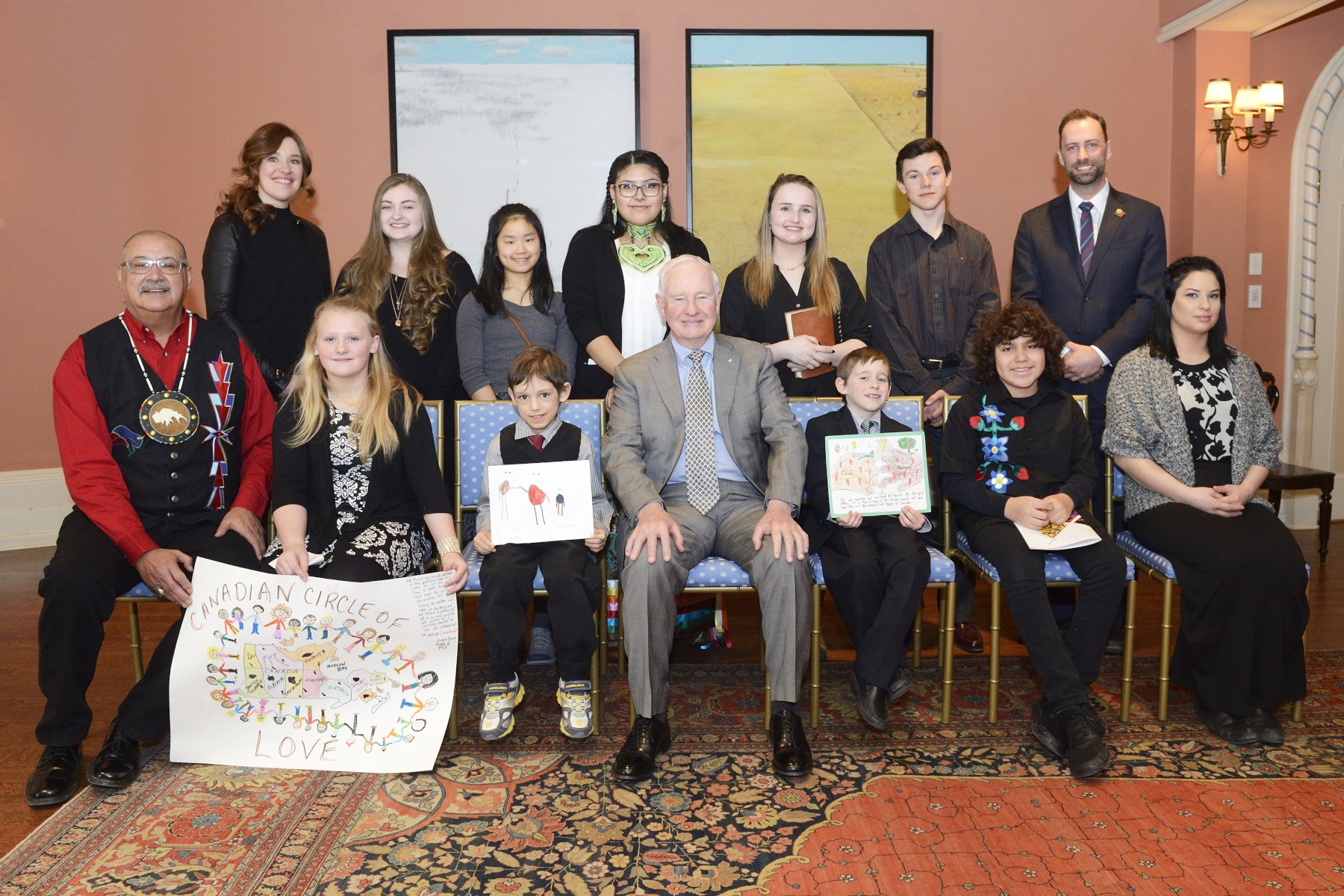 The selected recipients of the inaugural Imagine a Canada competition gathered for a photo with the Governor General, Ms. Hughes, Mr. Arcand and Mr. Moran.