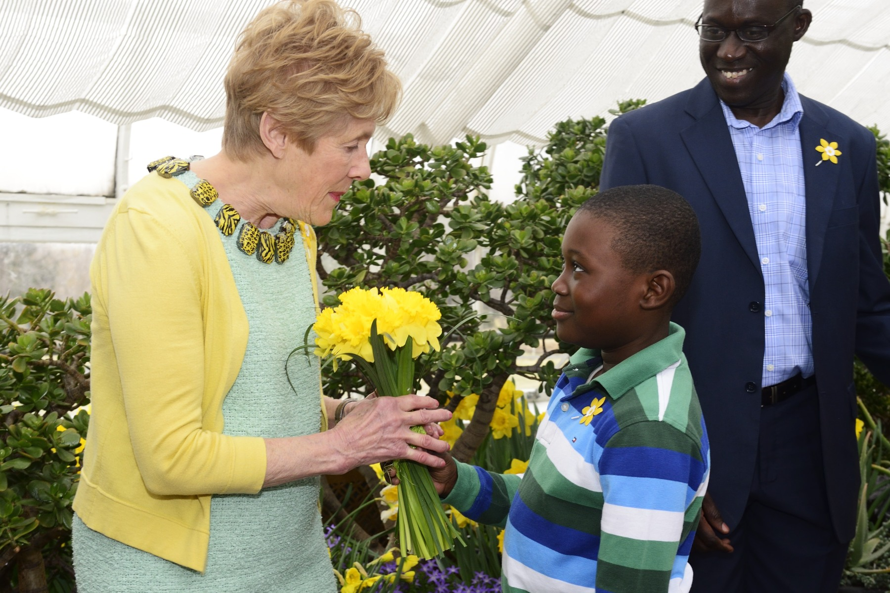 Mrs. Johnston received a bouquet of daffodils from cancer patient Melvic Affi, who is 8 years old.