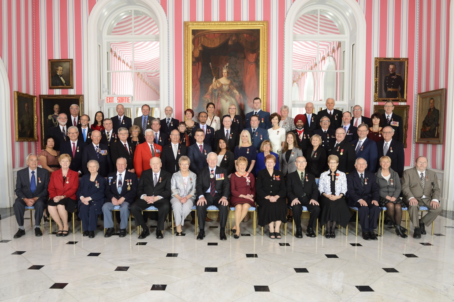 Their Excellencies are pictured with the first 55 recipients of the new Sovereign's Medal for Volunteers.
