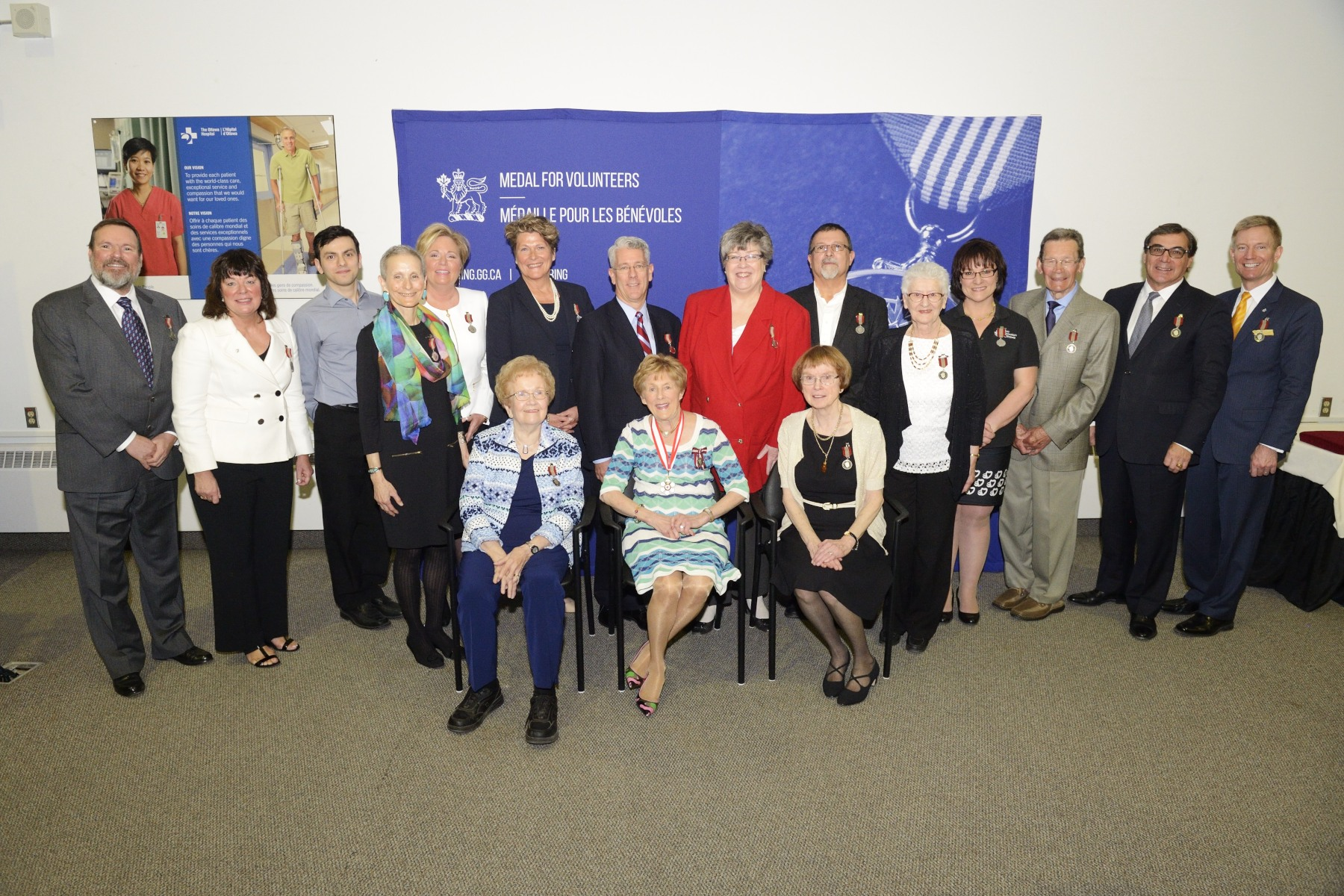 Her Excellency is accompanied by the 16 recipients who were recognized for their work.