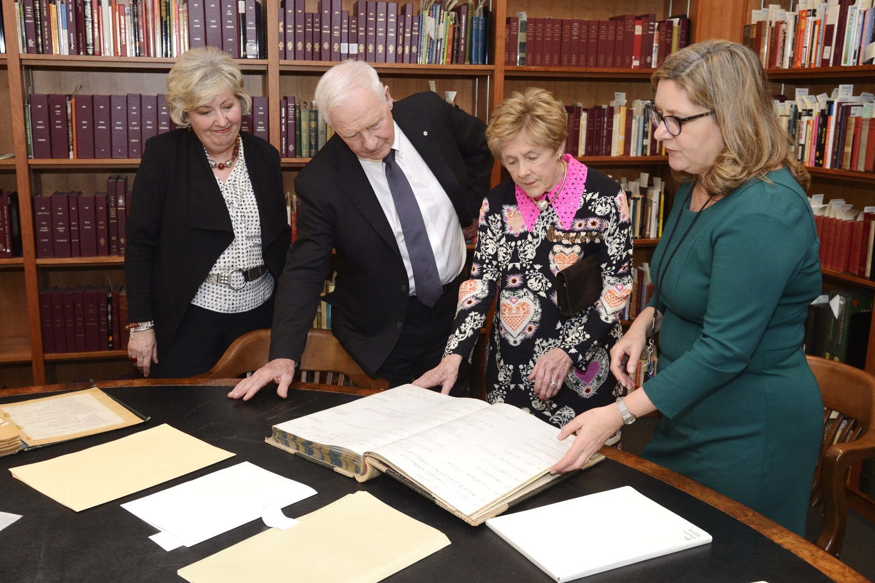Before the evening book launch, Their Excellencies were joined by Toronto City Librarian Ms. Vickery Bowles, who showed them a few examples of their rare books collection.