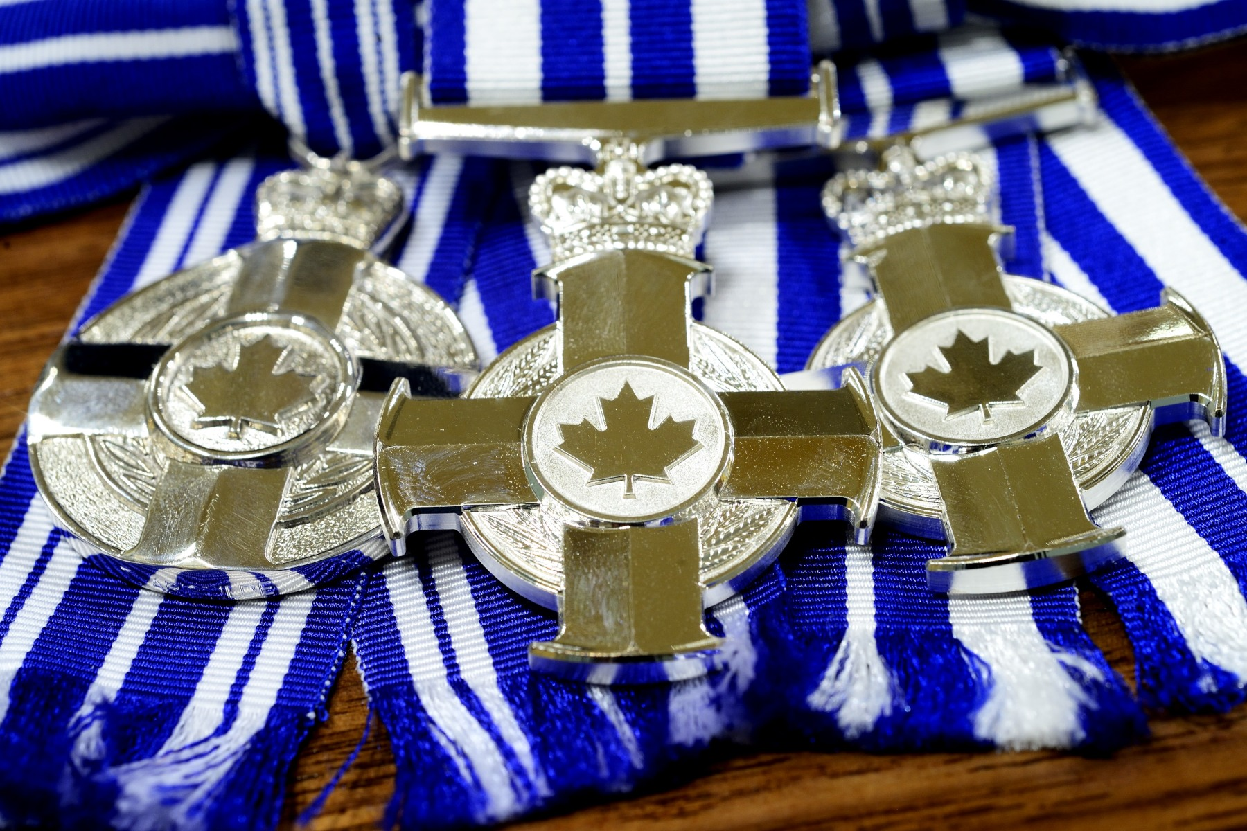 The Meritorious Service Medal is a circular silver medal bearing the Royal Crown: on one side of which appears the design of the Cross, and on the other appears the Royal Cypher, and within a double circle the inscription MERITORIOUS SERVICE MÉRITOIRE.