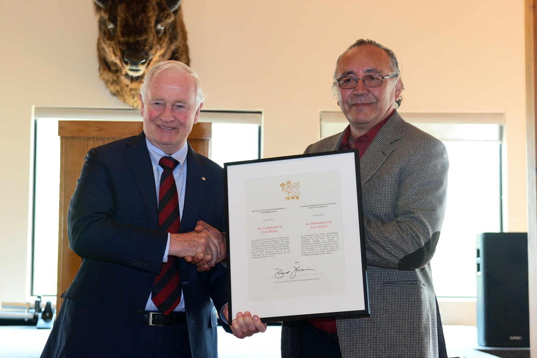 His Excellency presented to the Governor General's Commendation for Outstanding Service to Fort McKay First Nation Chief Jim Boucher in recognition of the community's extraordinary efforts made in the face of devastating wildfires in May 2016. During the peak of the wildfires, the entire community welcomed thousands of evacuees and provided them with food and temporary shelters.  The community of Fort McKay demonstrated initiative and selflessness, and is to be commended for its tremendous spirit and the remarkable example it has set.