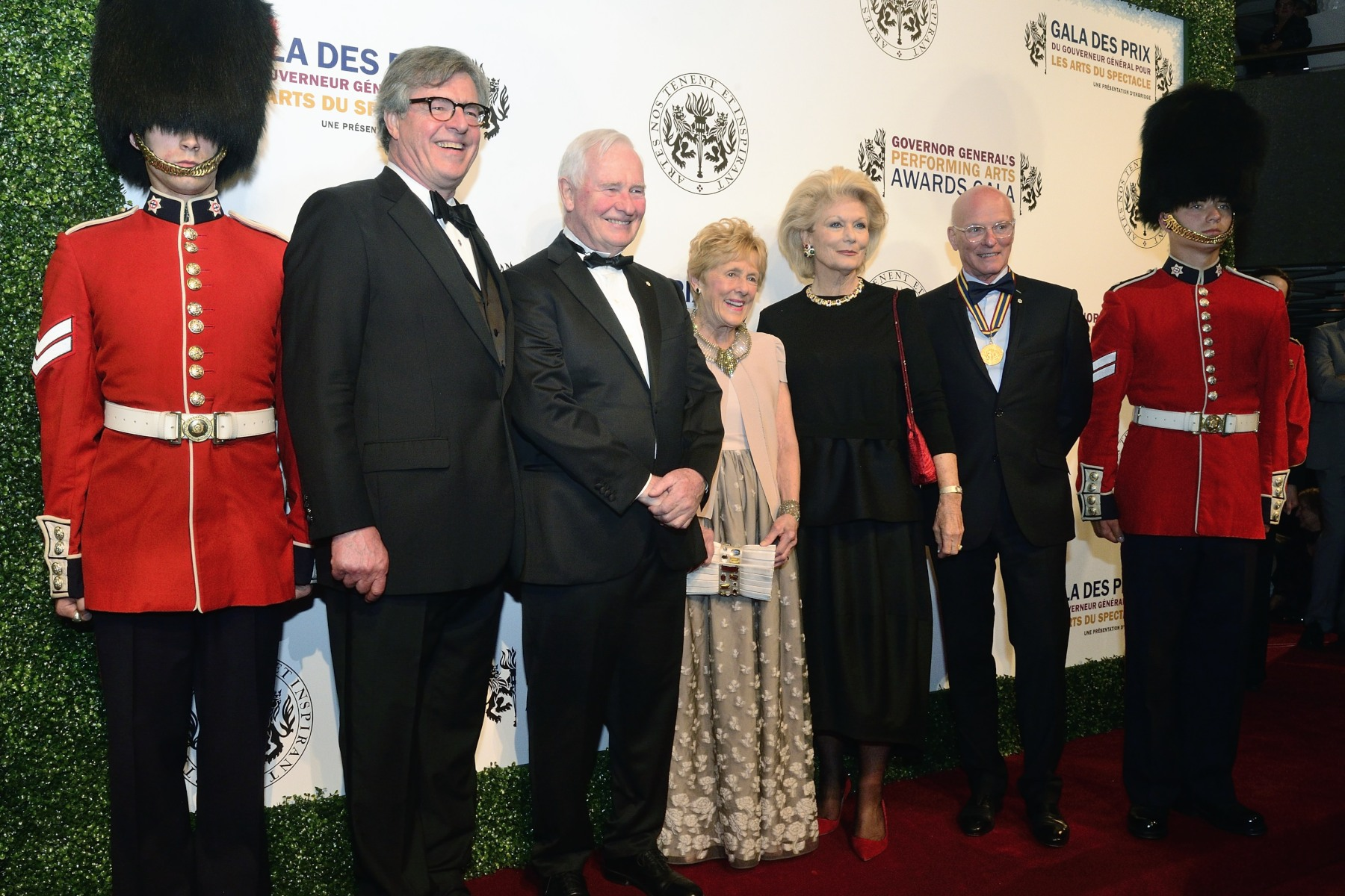 The Governor General and Mrs. Johnston took a pose on the red carpet upon their arrival at the National Art Centre. They are accompanied here by Douglas Knight (far left), Chair of the GGPAA Fondation and Paul-André Fortier (far right), Co-Chair of the GGPAA Foundation.
