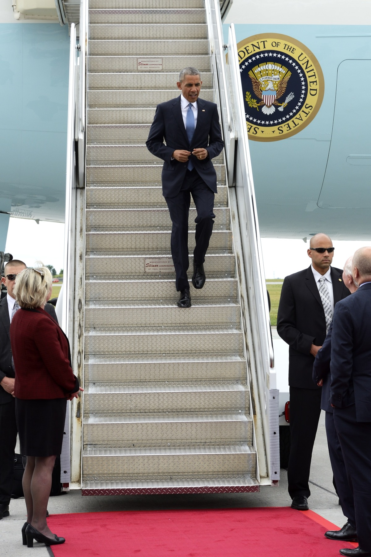 President Obama was greeted at the bottom of the steps by the Governor General.