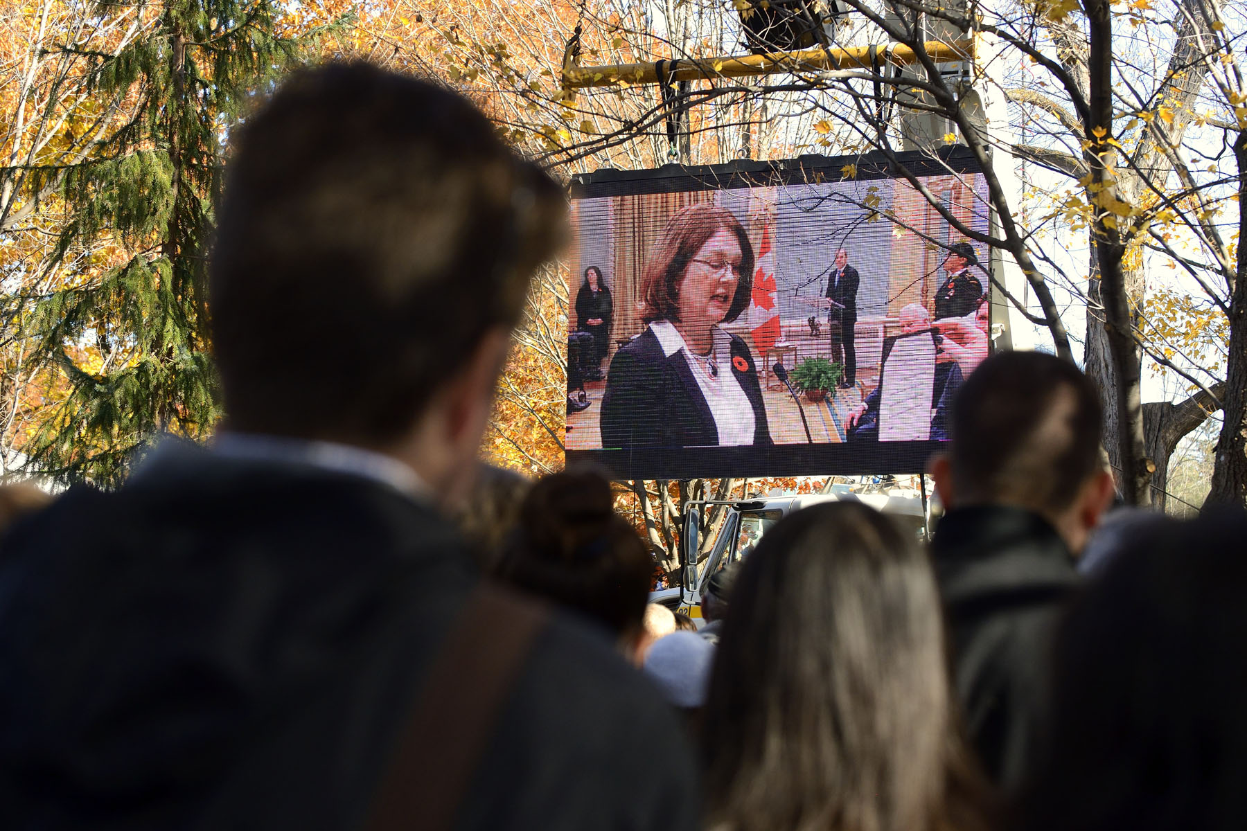 Visitors were able to watch the ceremony on two screens located on the grounds.
