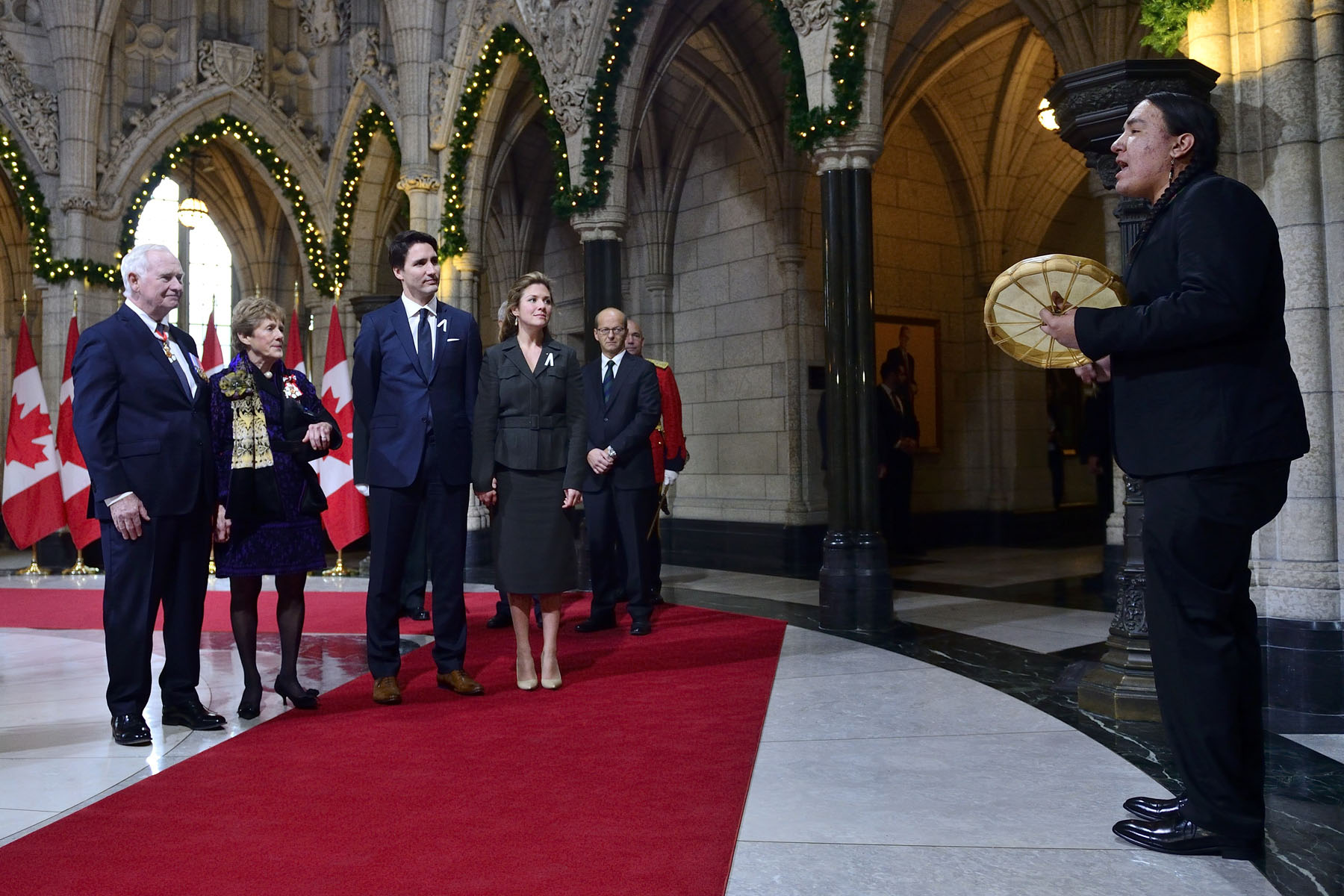 In the Hall of Honour, the Governor General, Her Excellency Sharon Johnston, the Right Honourable Justin Trudeau, Prime Minister of Canada, and Sophie Grégoire-Trudeau listened to an honour song.