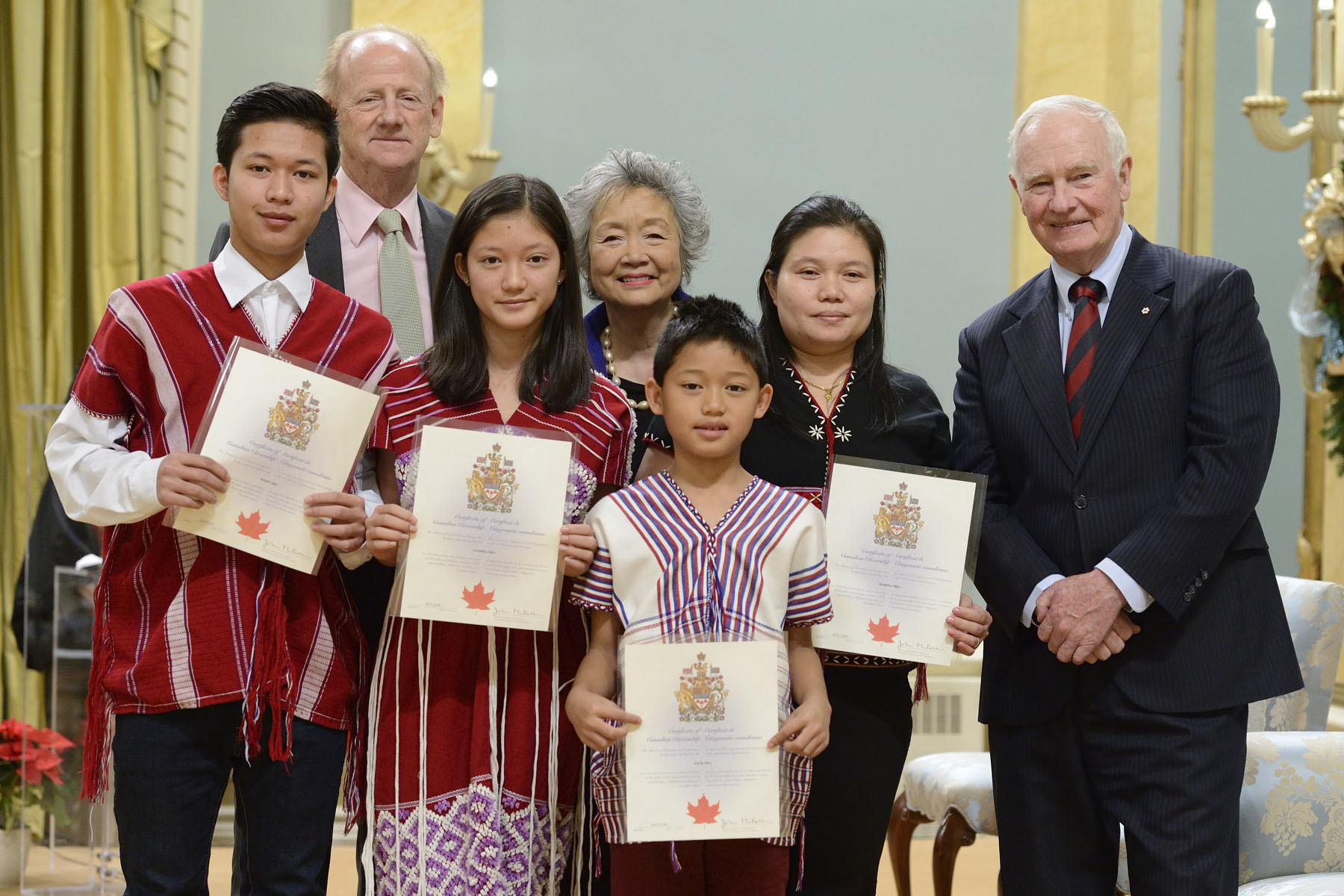 A family of new Canadians received their citizenship certificate.