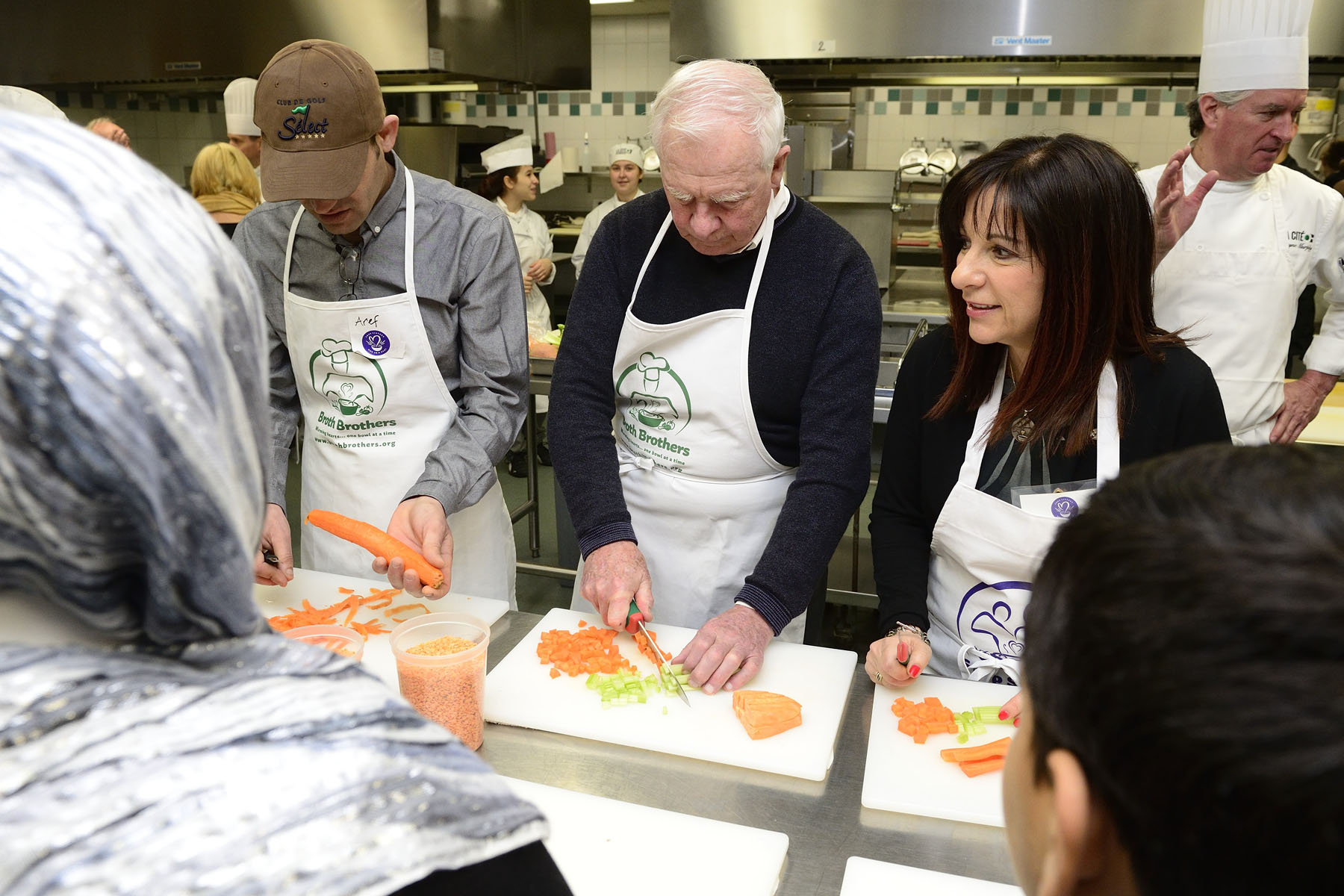 Mrs. Sharon Hapton (right), founder and CEO of Soup Sisters and Broth Brothers and recent recipient of the Meritorious Service Medal, was on hand to help prepare the vegetables for the soup.