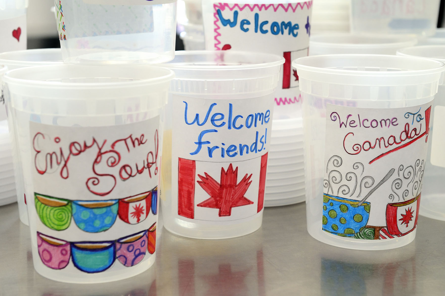 Labels were made by Ottawa elementary school children to provide a warm welcome to newly arrived Syrian refugees.