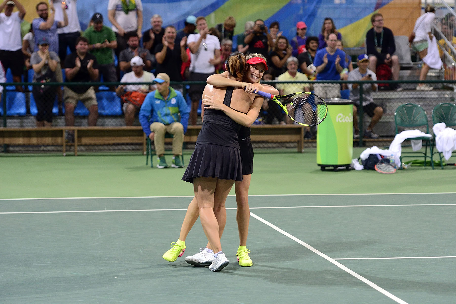 The Canadian duo won this first-round match and celebrated on court.