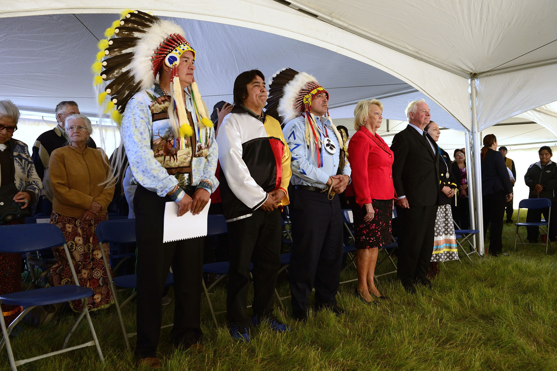 The ceremony hosted by Chief Lynn Acoose of the Treaty No. 4 Executive Council (far right).  Her Honour the Honourable Vaughn Solomon Schofield, Lieutenant Governor of Saskatchewan, also attended the ceremony (pink jacket).