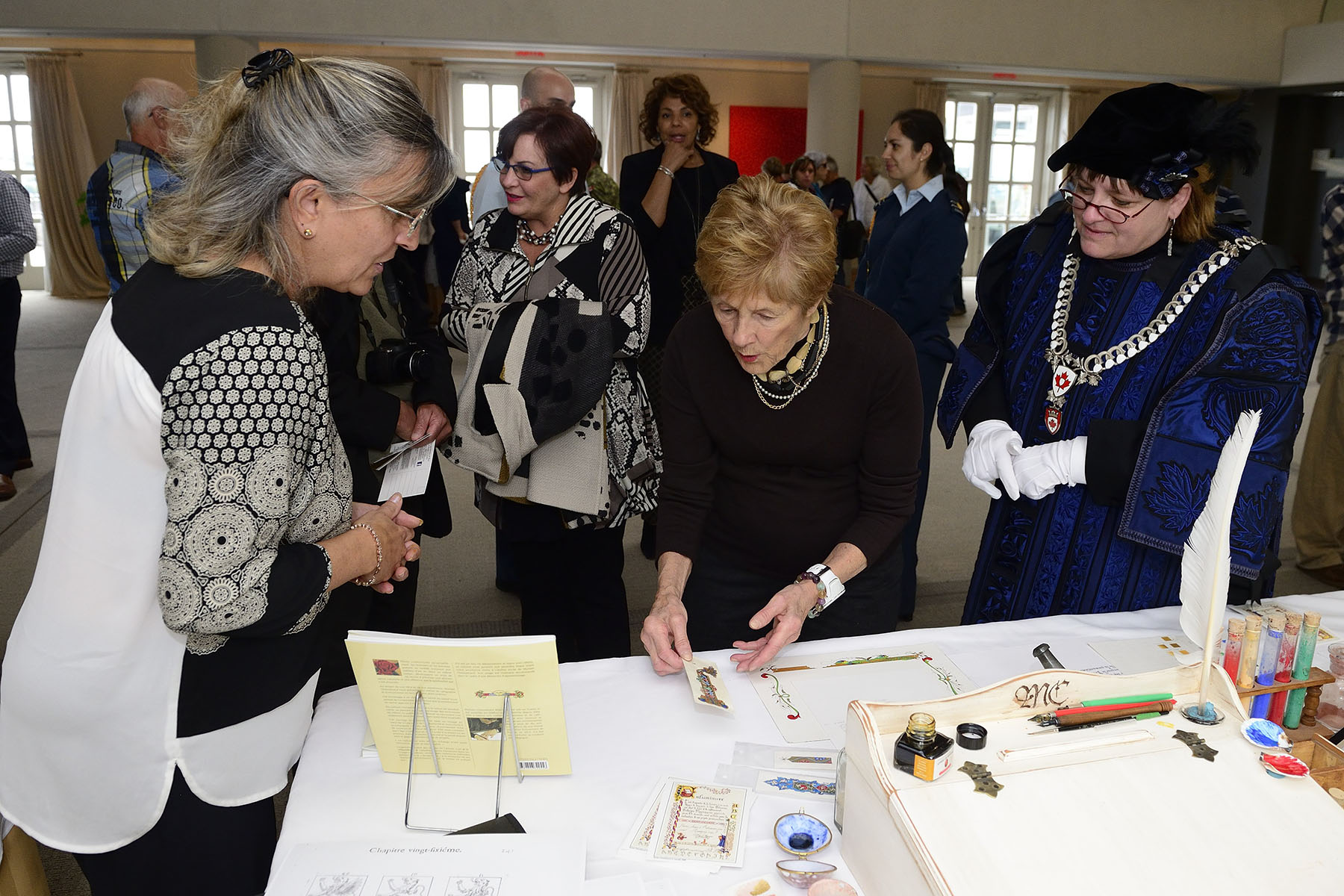 Representatives from the Canadian Heraldic Authority were on hand to showcase coats of arms and emblems. A calligraphy demonstration was also offered by Myriam Chesseboeuf, a local artist.