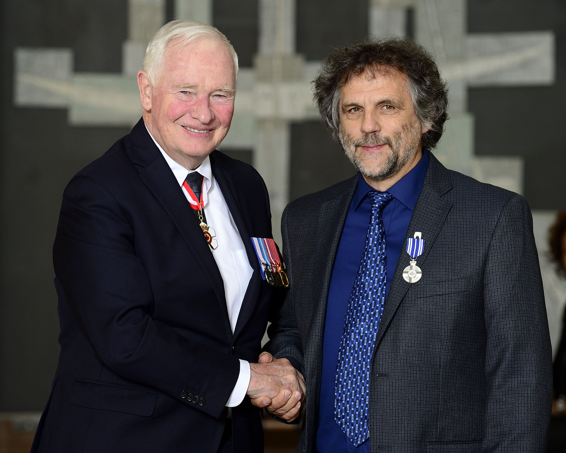 His Excellency presented Philippe Gélinas with a Meritorious Service Medal (Civil Division) for founding l'Atelier du Conte en Musique et en Images Inc. to raise awareness of how medieval music has shaped Quebec's culture. History comes alive through concerts and workshops in communities across Canada, as audiences see, hear and sometimes play the cittern, dulcimer, hurdy gurdy, crumhorn, sackbut and lute. These are just a few of the more than 30 replicas of traditional instruments that the group features through its distinctive storytelling.