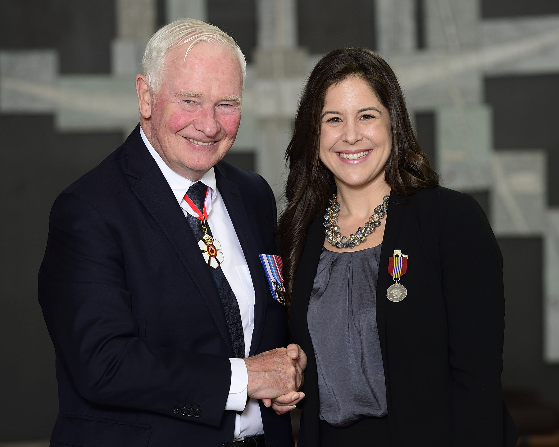 Mélanie Monique McGrath received the Sovereign's Medal for Volunteers for her many volunteer roles, including as president of the Jeux de l'Acadie. She has always been an outstanding spokesperson and has established ties between the games and other Francophone organizations to benefit all Acadian youth.