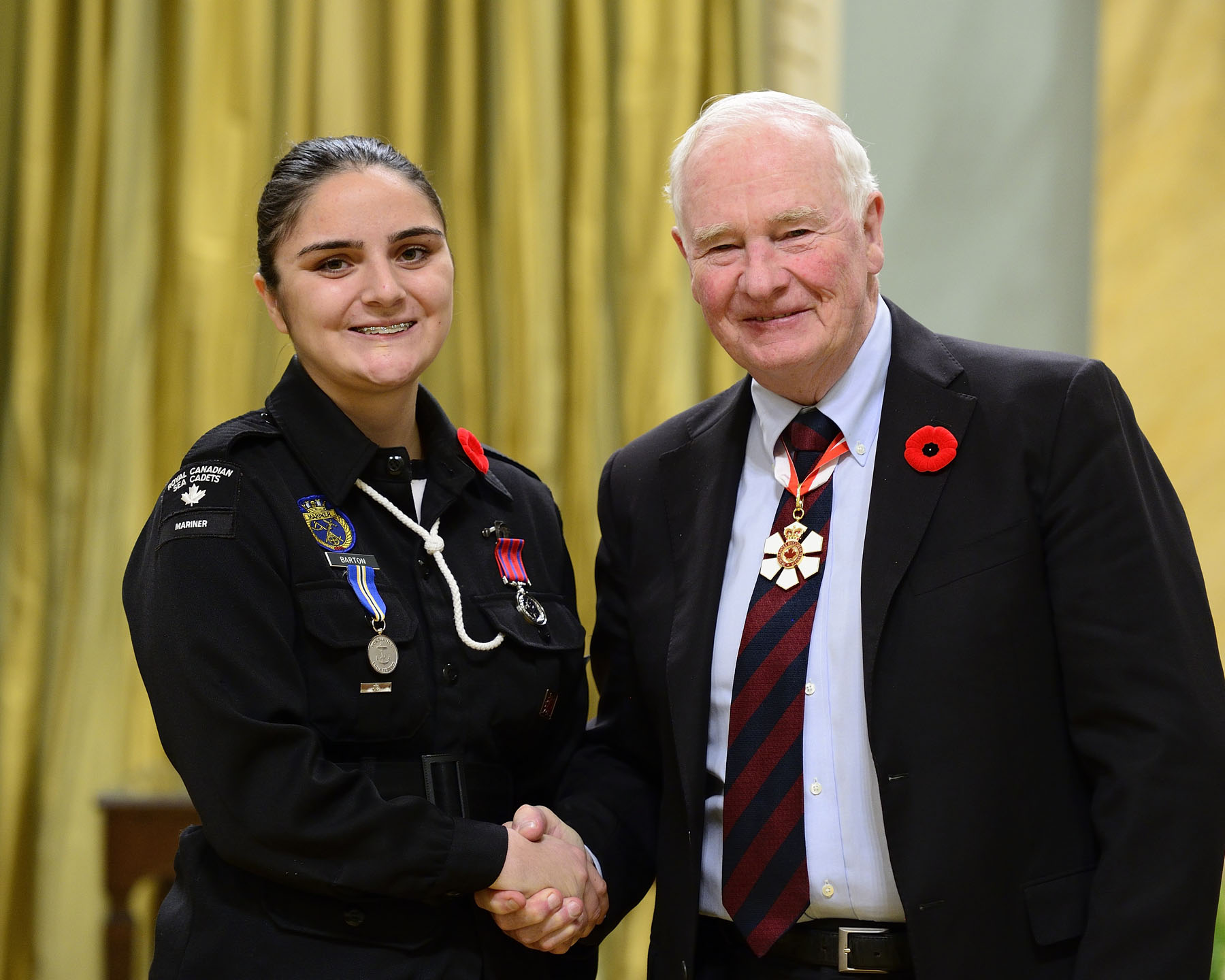 On September 29, 2013, Cadet Master Seaman Kristianna Barton, M.B., rescued a man who was in danger of drowning after he had fallen off a dock into Gull Lake, north of Kaladar, Ontario. Ms. Barton jumped into the cold water and made her way out to the victim, who could not swim. The man panicked and pushed Ms. Barton under the water several times, but she still managed to bring him back to the dock.