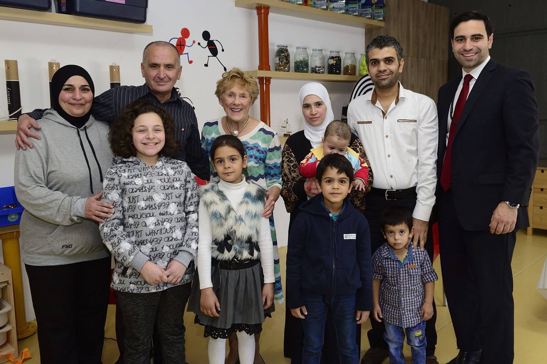 Official photo of Her Excellency and Peter Fragiskatos with the Syrian refugee families.