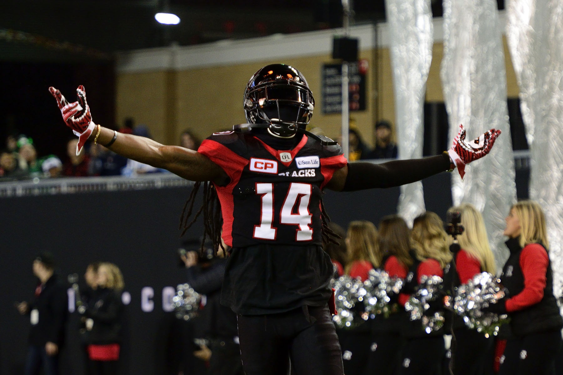 Abdul Kanneh, defensive back for the Ottawa REDBLACKS rallies the crowd before the game.