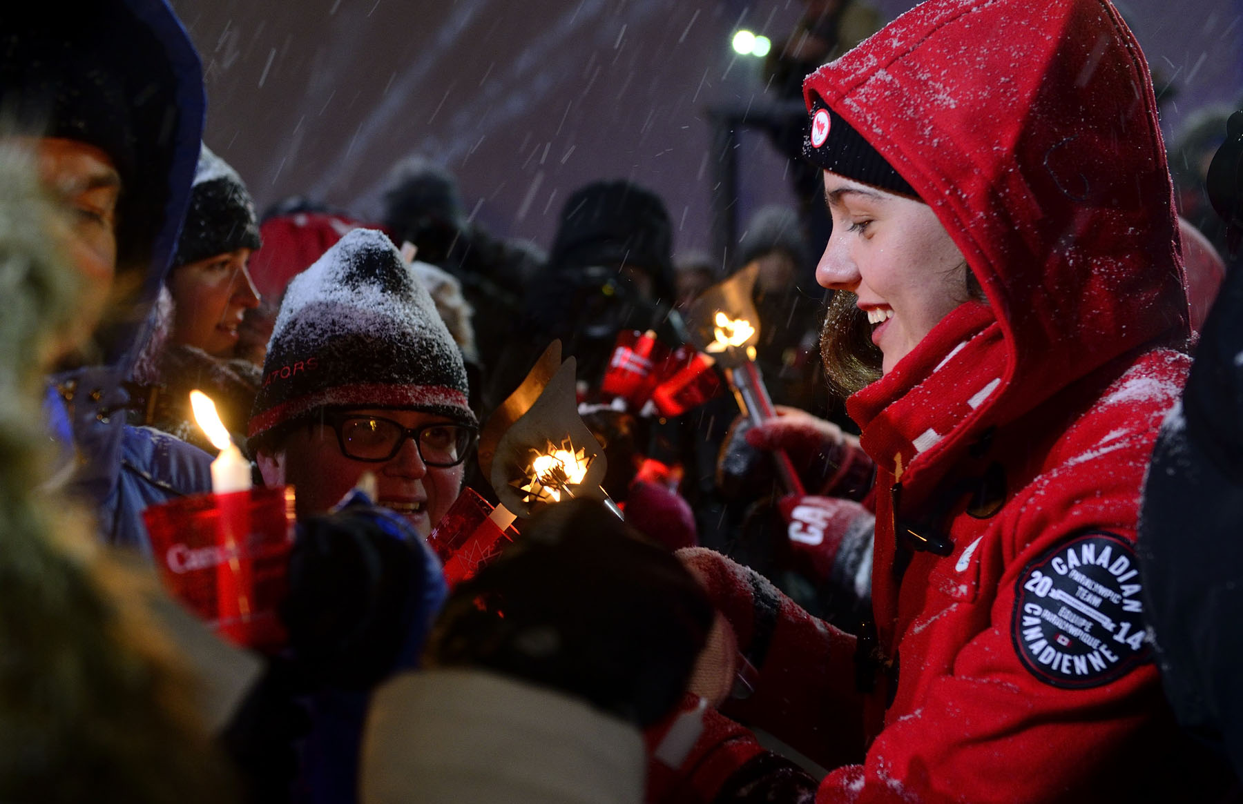 Later, Canadian swimmer Aurélie Rivard shared the fire of friendship with the public around the Centennial Flame.