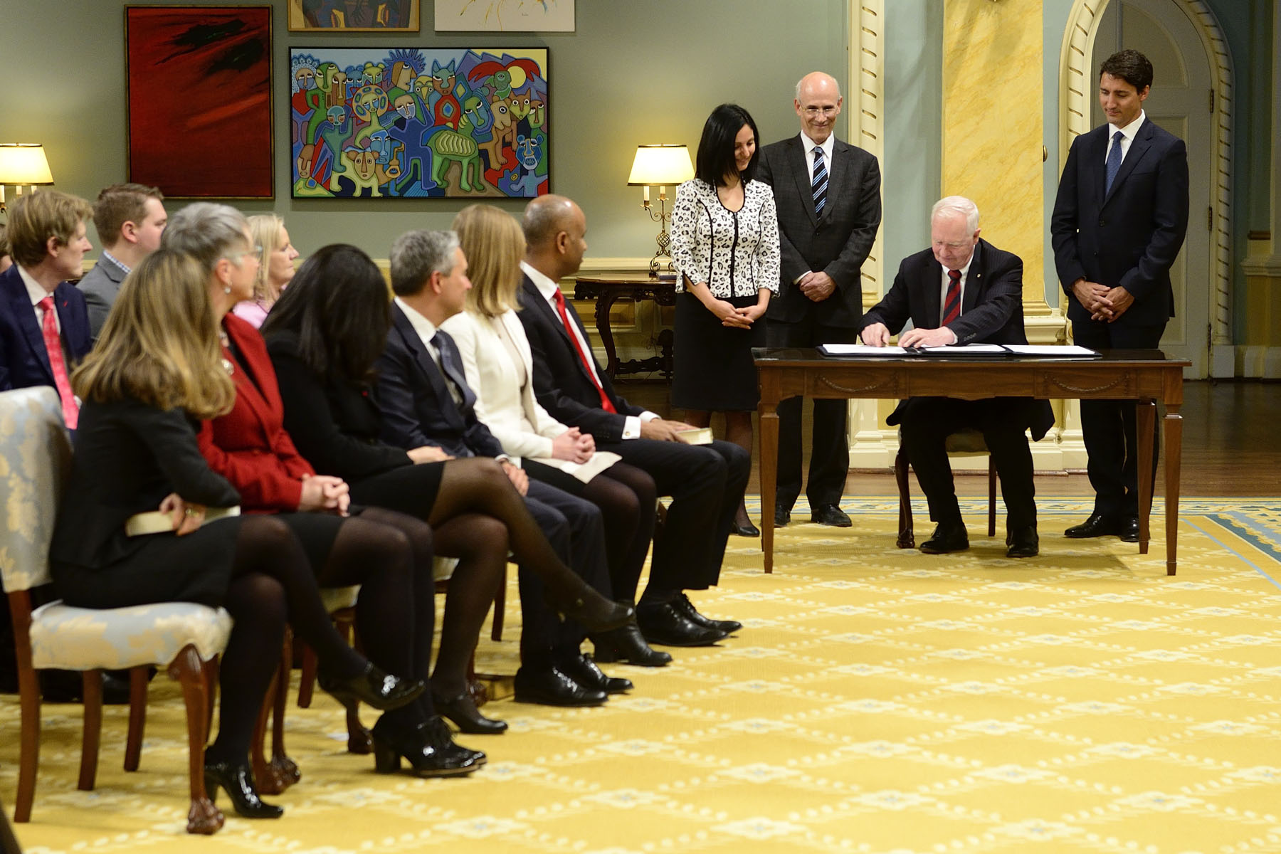 Following the swearing-in of the last new member of the ministry, the governor general, the prime minister and the clerk of the Privy council sign the oath books to formally attest to the swearing-in of the ministry.