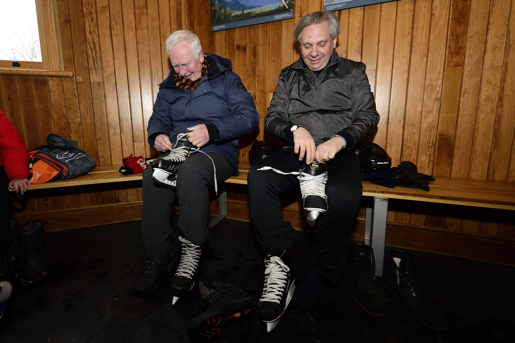 Governor General David Johnston and Dr. Mark Kristmanson, Chief Executive Officer of the National Capital Commission, are lacing up their skates inside the Winter Pavilion before trying out Rideau Hall's newly refrigerated skating rink.